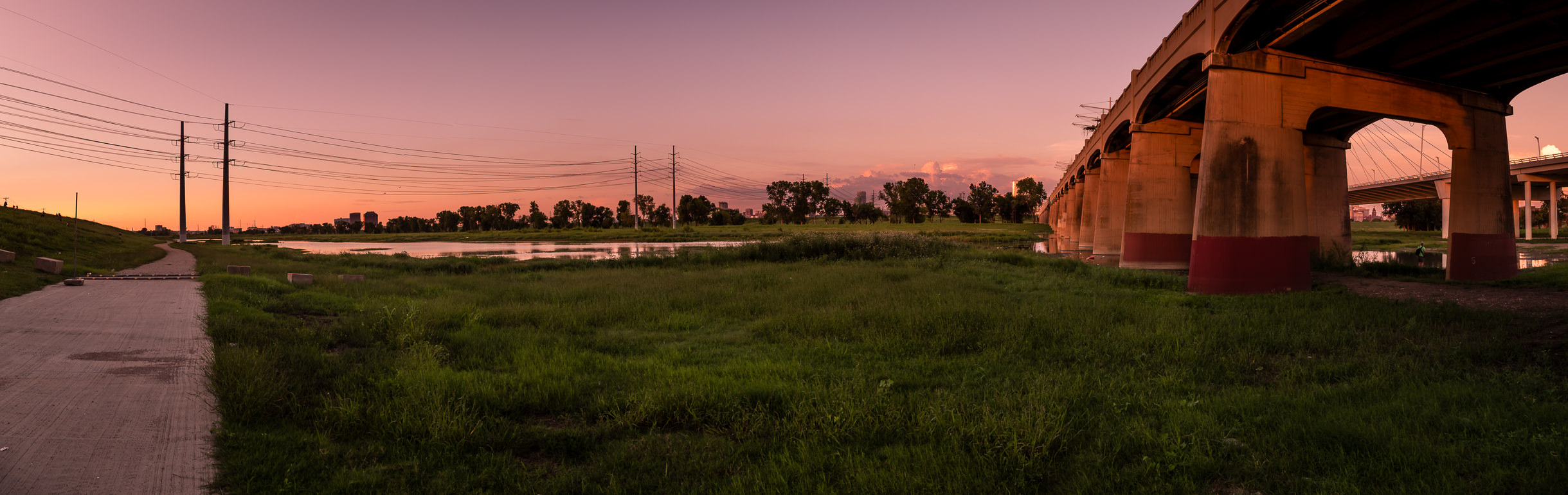 The sun sets on the Trinity River floodplain at the Commerce Street Viaduct in Dallas.