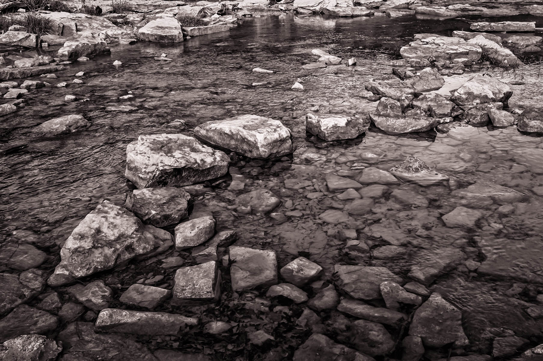 Texas' Paluxy River flows over and around rocks at Dinosaur Valley State Park.