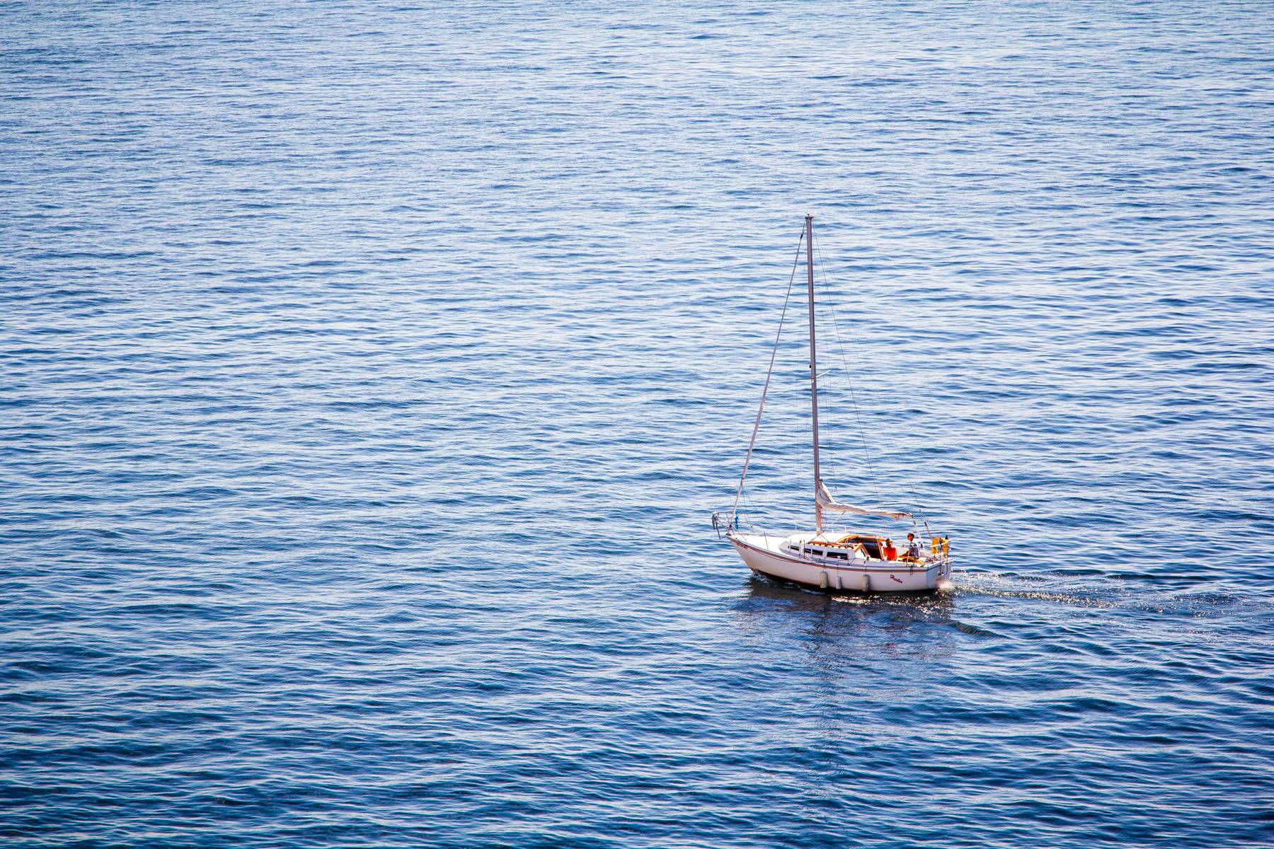 A sailboat cruises Puget Sound just north of Seattle.