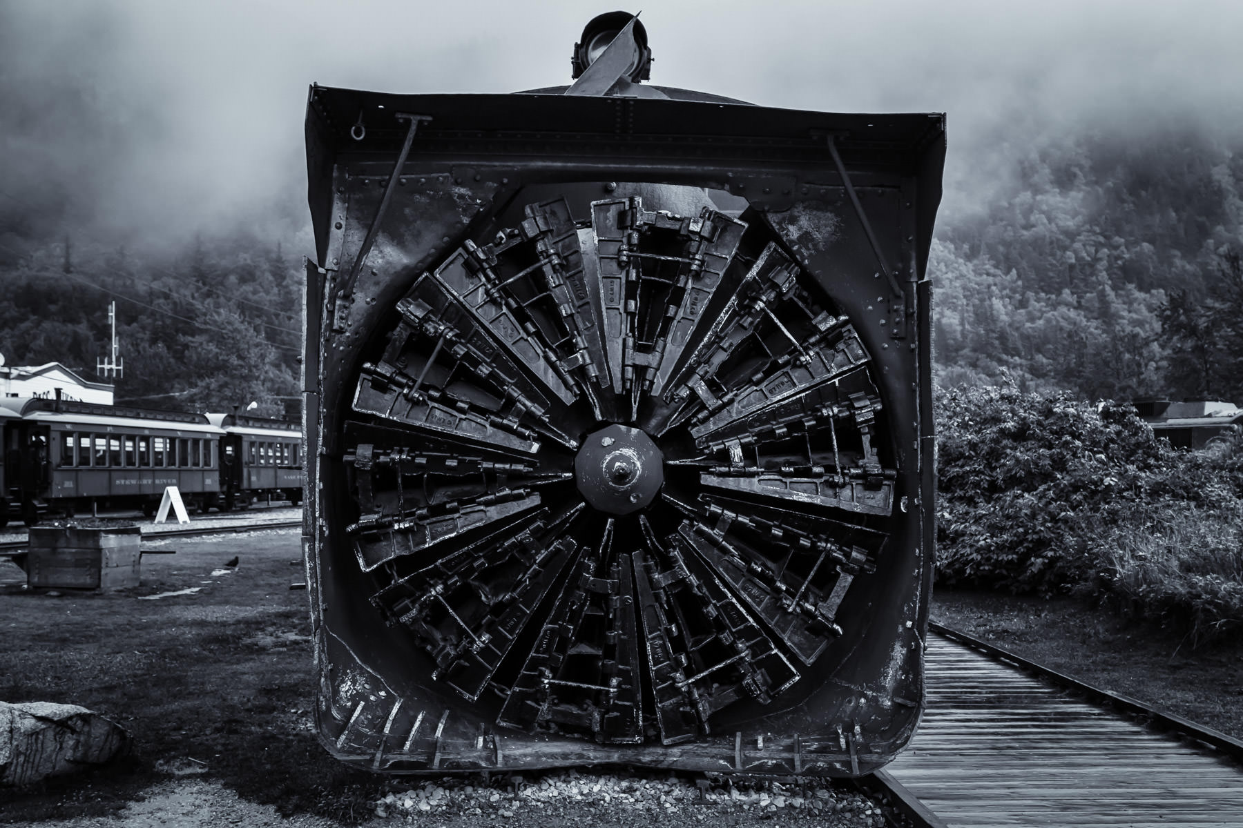 The rotary snow plow on the engine of the White Pass & Yukon Route Railway on a wet, misty morning in Skagway, Alaska.