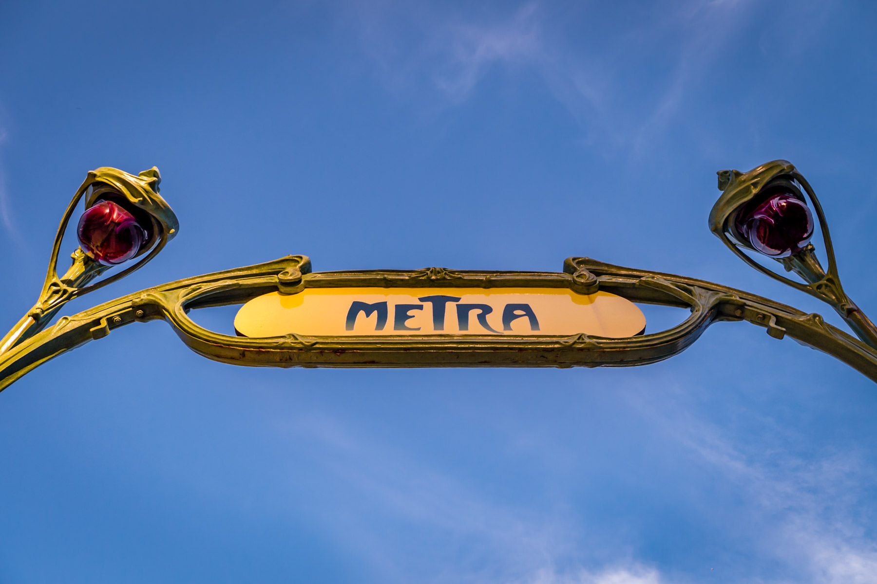 A replica of an Art Nouveau-styled Paris Métro sign—a gift from the city of Paris—greets passengers at Chicago's Van Buren Street Metra Station.