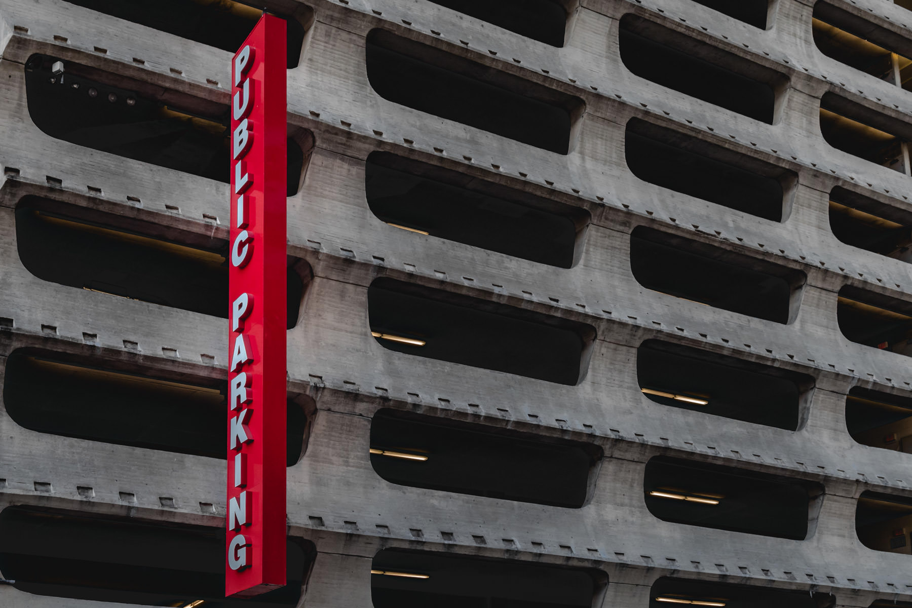 A bright red parking garage sign, spotted in Downtown Dallas.