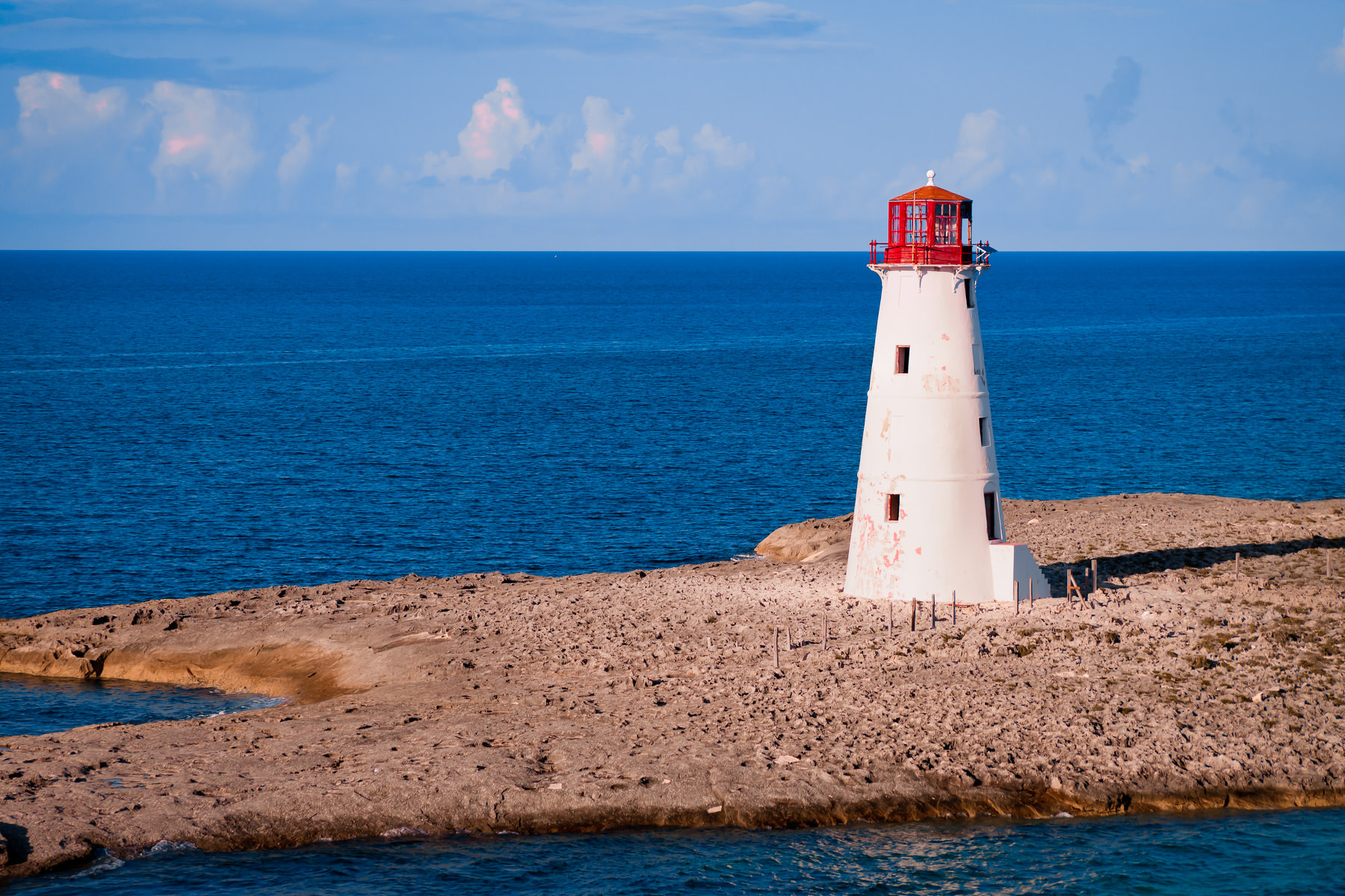The Nassau Harbour Lighthouse sits abandoned on the western end of Colonial Beach at Nassau, Bahamas.