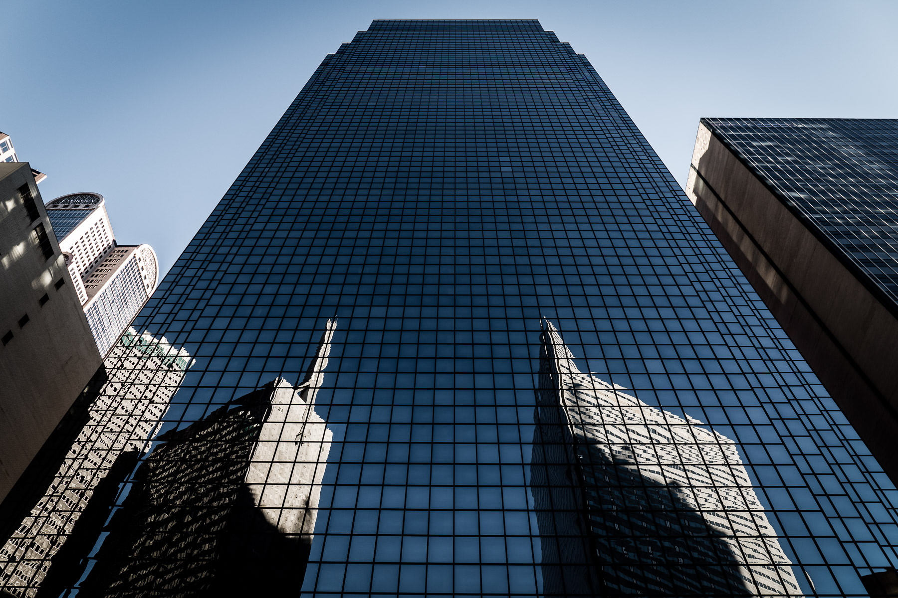 Downtown Dallas' Republic Gables Tower and Energy Plaza are reflected in the glass facade of the adjacent Thanksgiving Tower.
