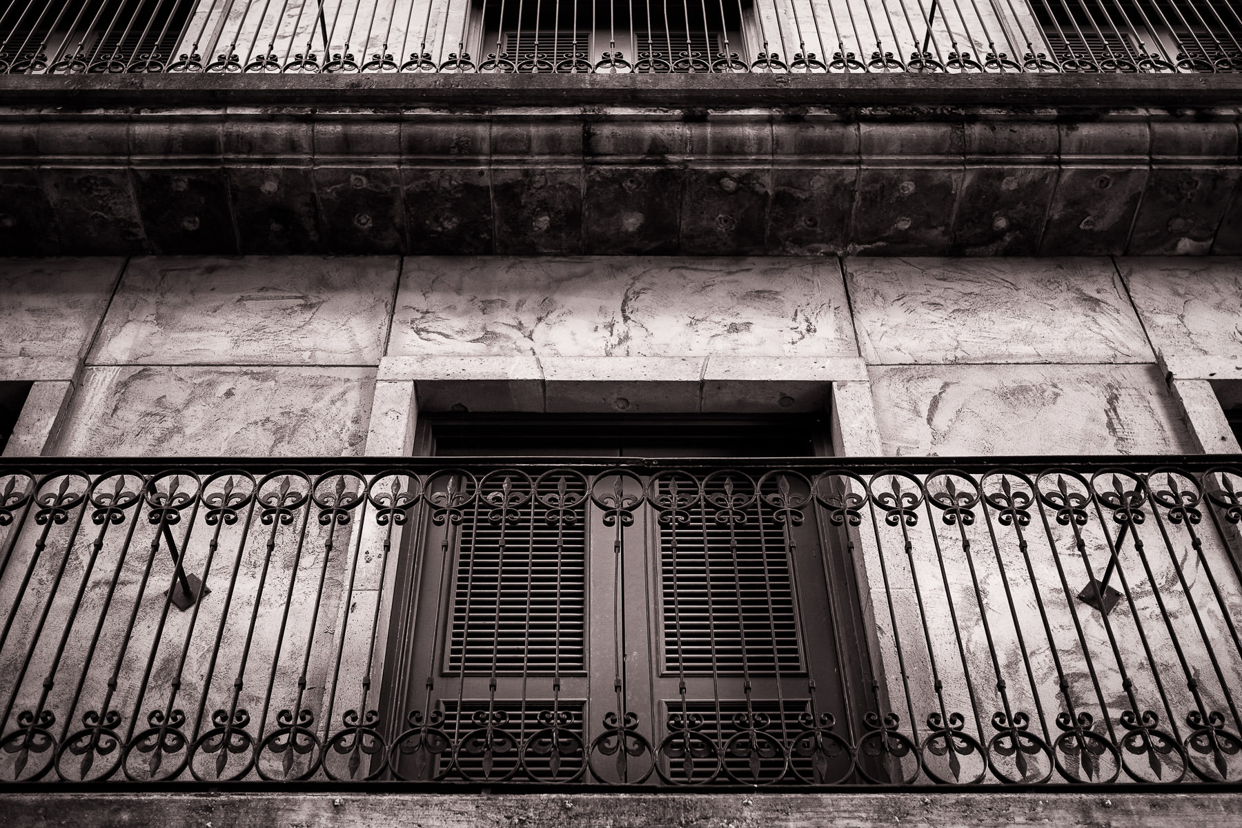 An ornate iron rail accentuates the Spanish-style architecture of an office building along the Mandalay Canal in Las Colinas, Irving, Texas.