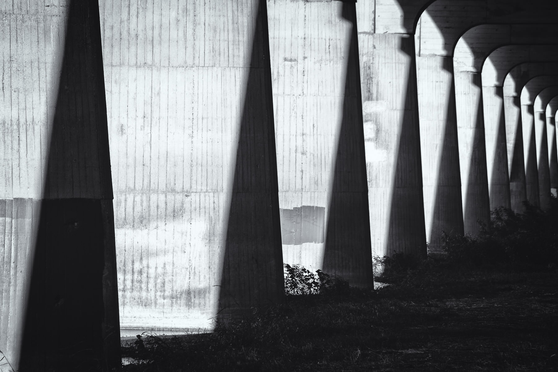Shadows fall on the supports for the Commerce Street Viaduct, Dallas, Texas.