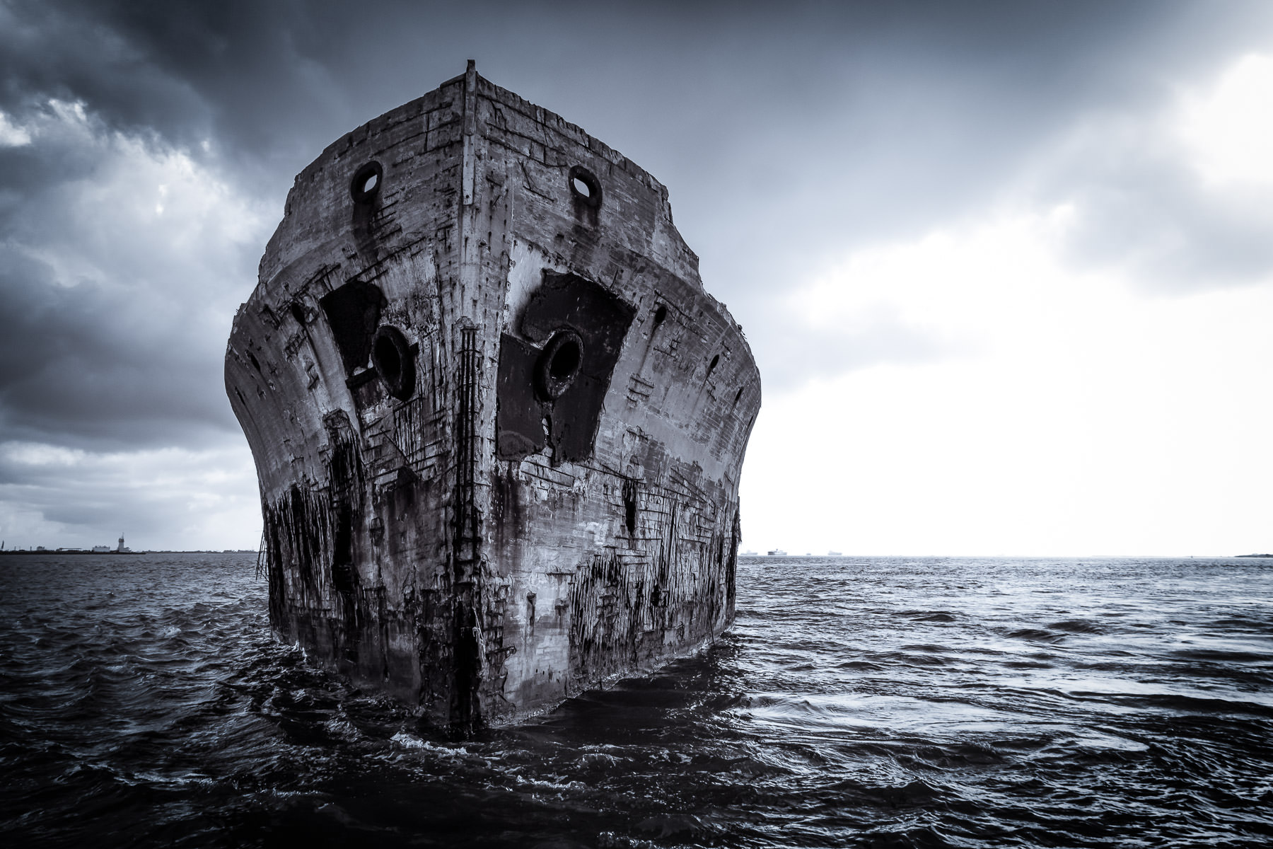 The bow of the wreck of the SS Selma—a 425-foot-long experimental concrete ship built in 1919 and sunk in 1922—rises from the waters of Texas' Galveston Bay.