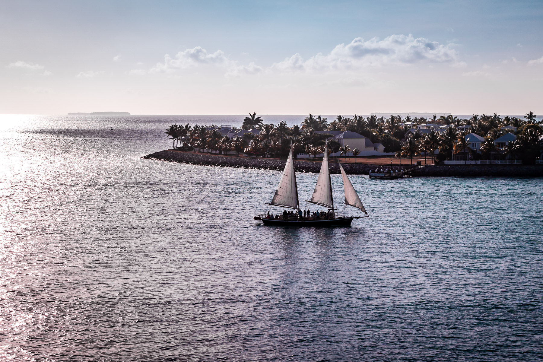 A sailboat sails into the harbor at Key West, Florida.