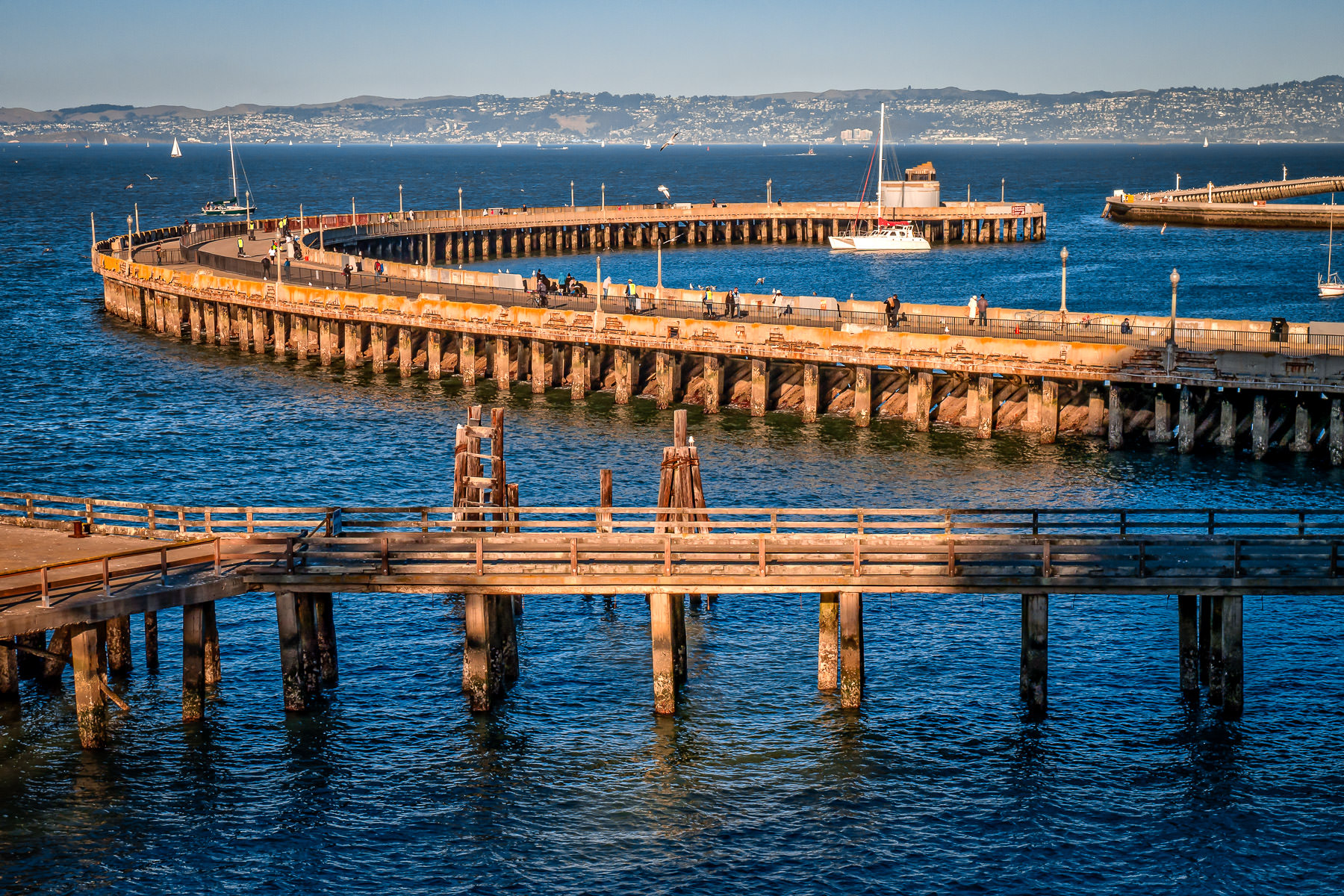San Francisco's 1400-foot-long Aquatic Park Pier curves out into San Francisco Bay.