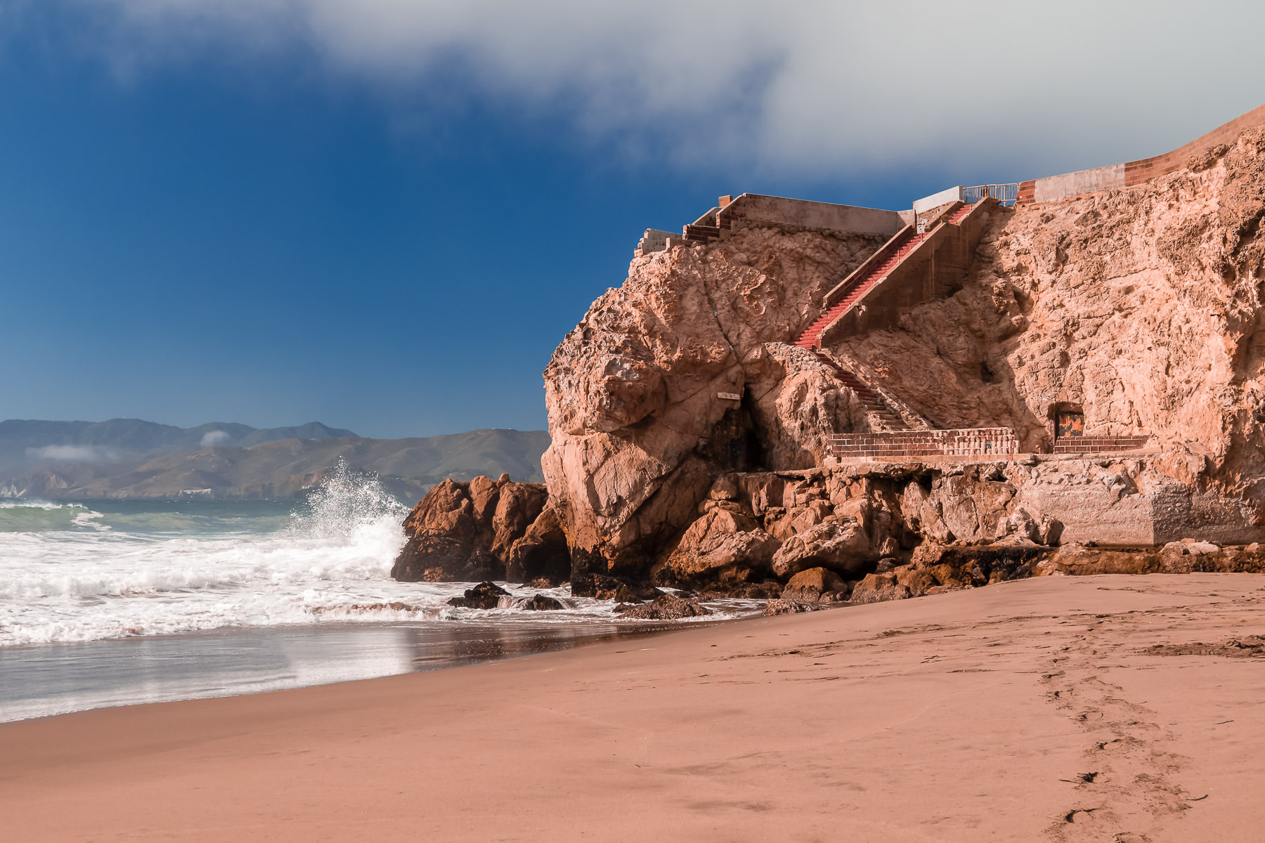 An old staircase leads from the beach near the Sutro Baths ruins at San Francisco's Lands End.
