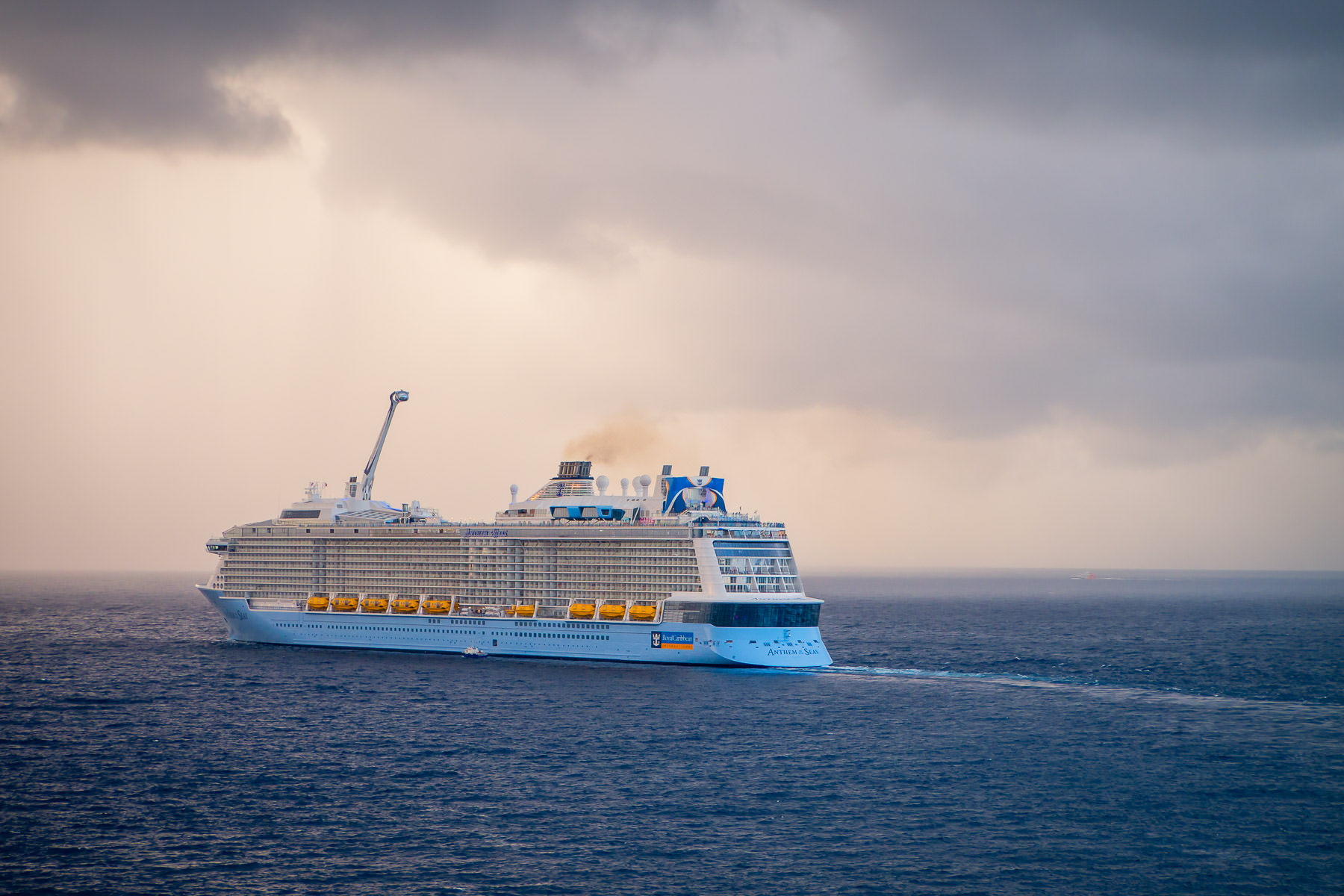 The cruise ship Anthem of the Seas departs Cozumel, Mexico, on a hazy, stormy day.