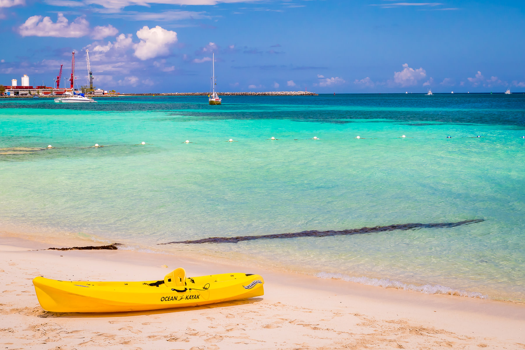 A kayak lies on the beach at the British Colonial Hilton in Nassau, Bahamas.