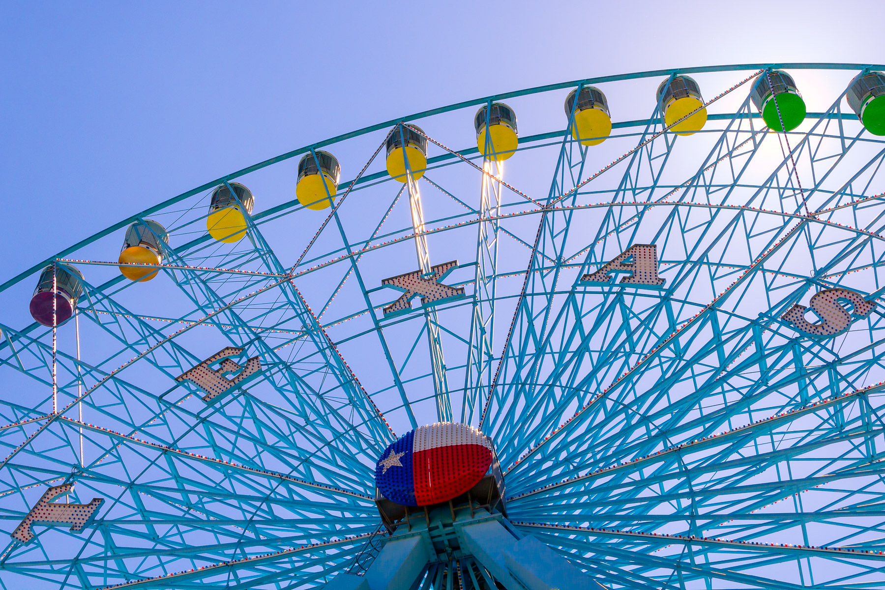 The Texas Star Ferris Wheel rises into the morning sky at Dallas' Fair Park.