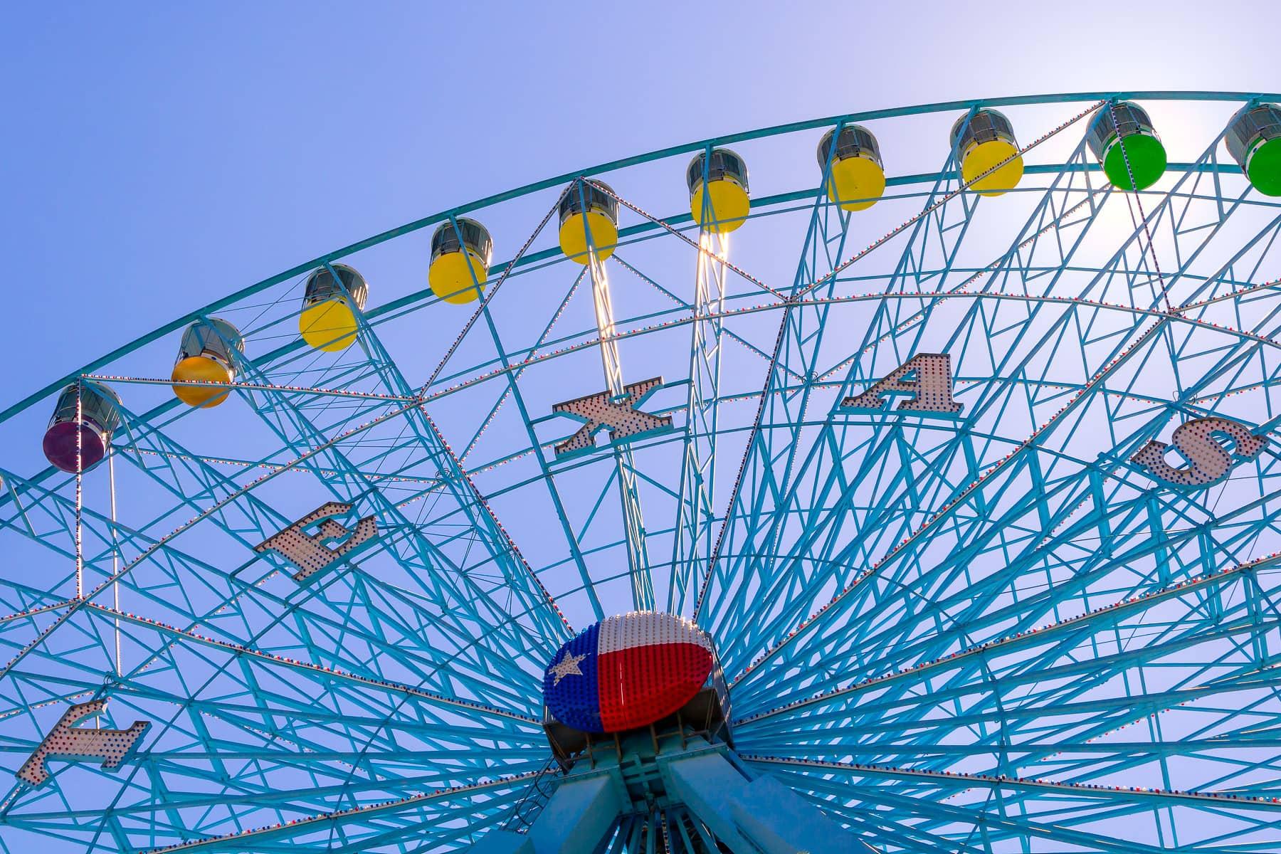 The Texas Star Ferris Wheel rises into the morning sky at Dallas' Fair Park.