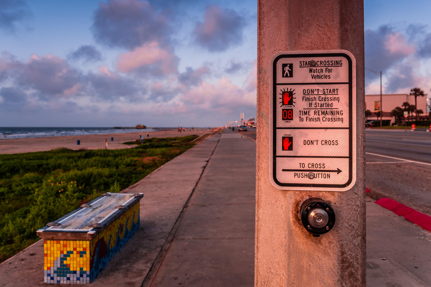 The early-morning sun illuminates a crosswalk on the seawall at Galveston, Texas.