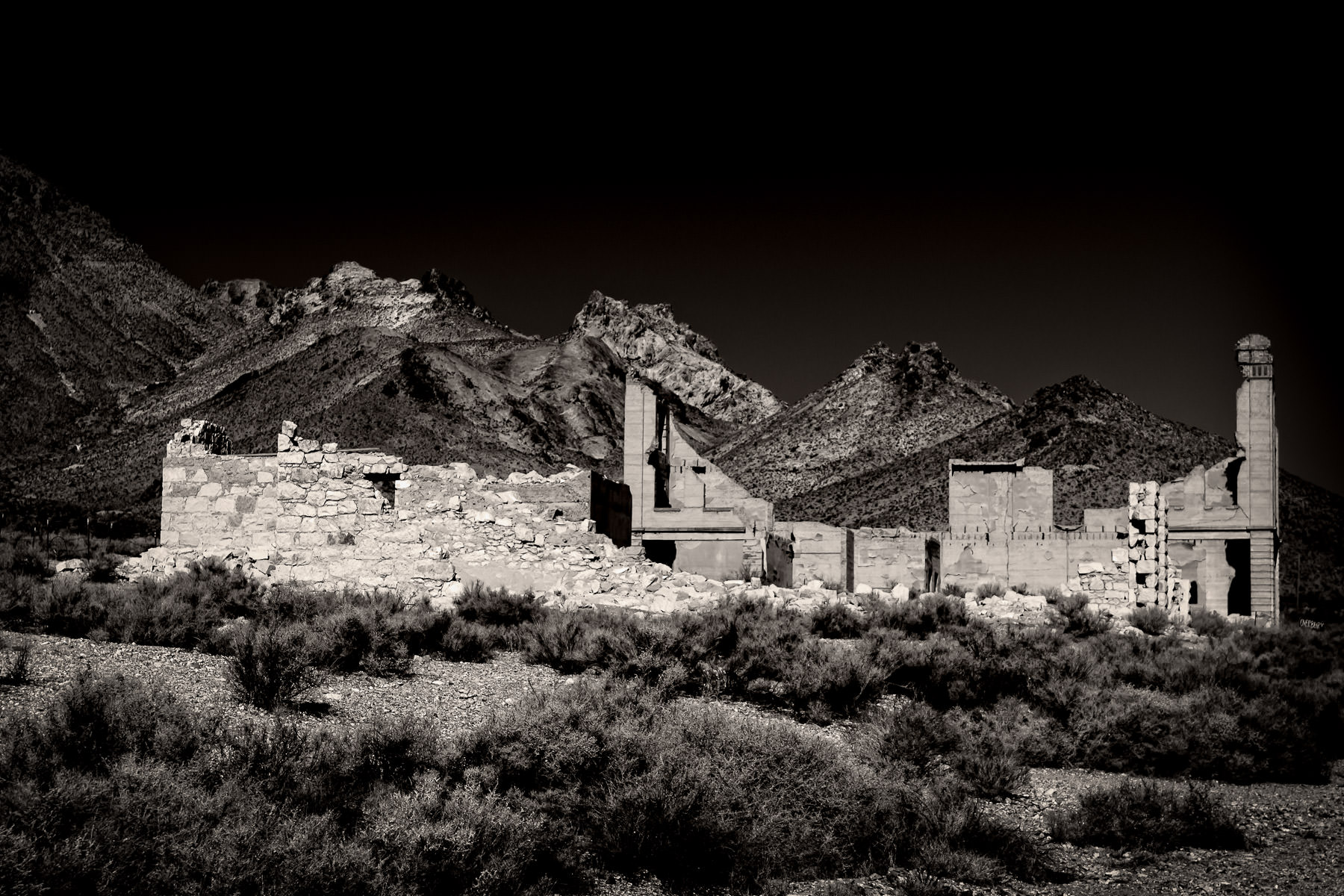 Ruins at the ghost town of Rhyolite, Nevada, sprawl in the desert near the California border.