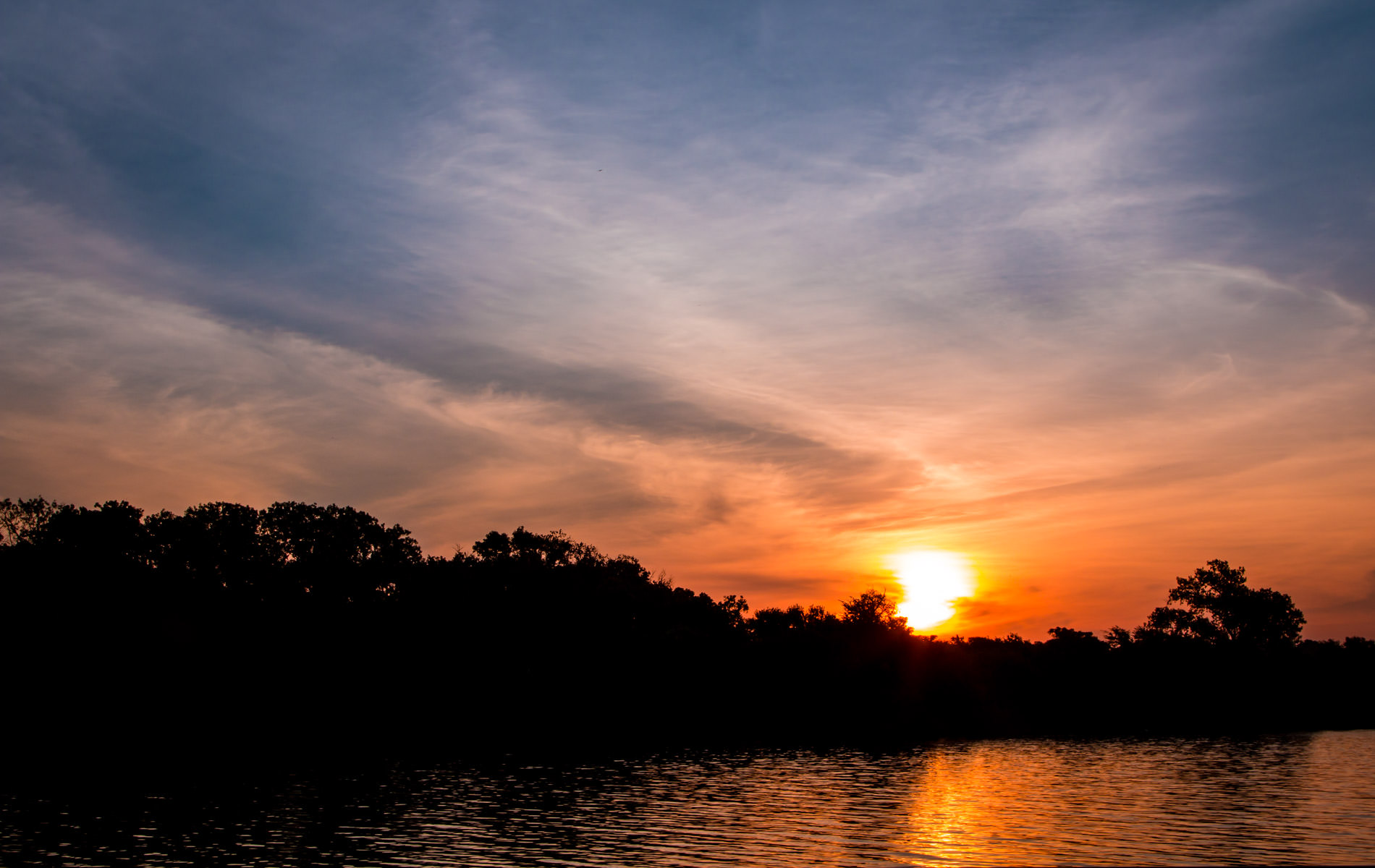 The sun rises over Dallas' White Rock Lake.