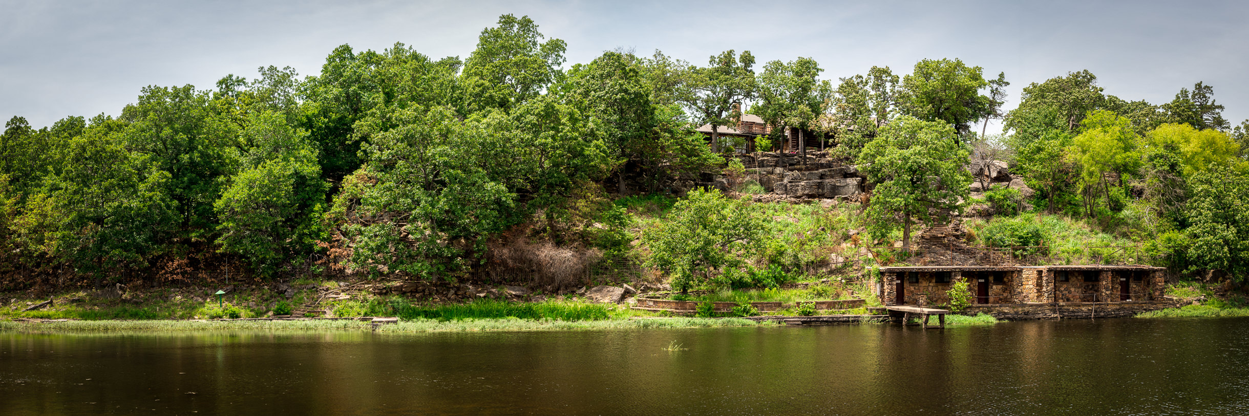 A panoramic view of the boathouse and hunting lodge at Woolaroc, the former ranch retreat of Frank Phillips—the founder of Phillips Petroleum—near Bartlesville, Oklahoma.
