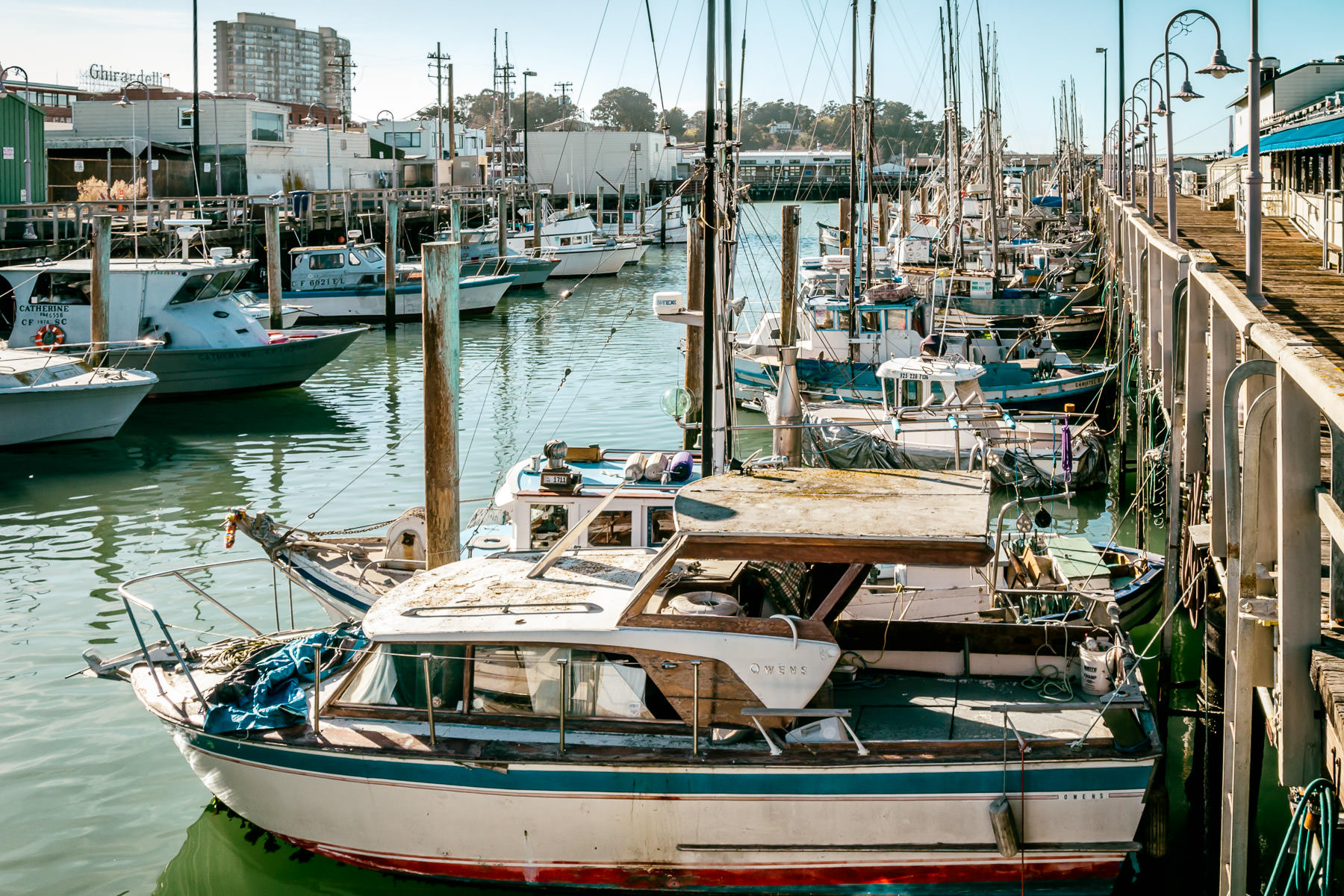 Boats docked at a pier along San Francisco's Fisherman's Wharf.