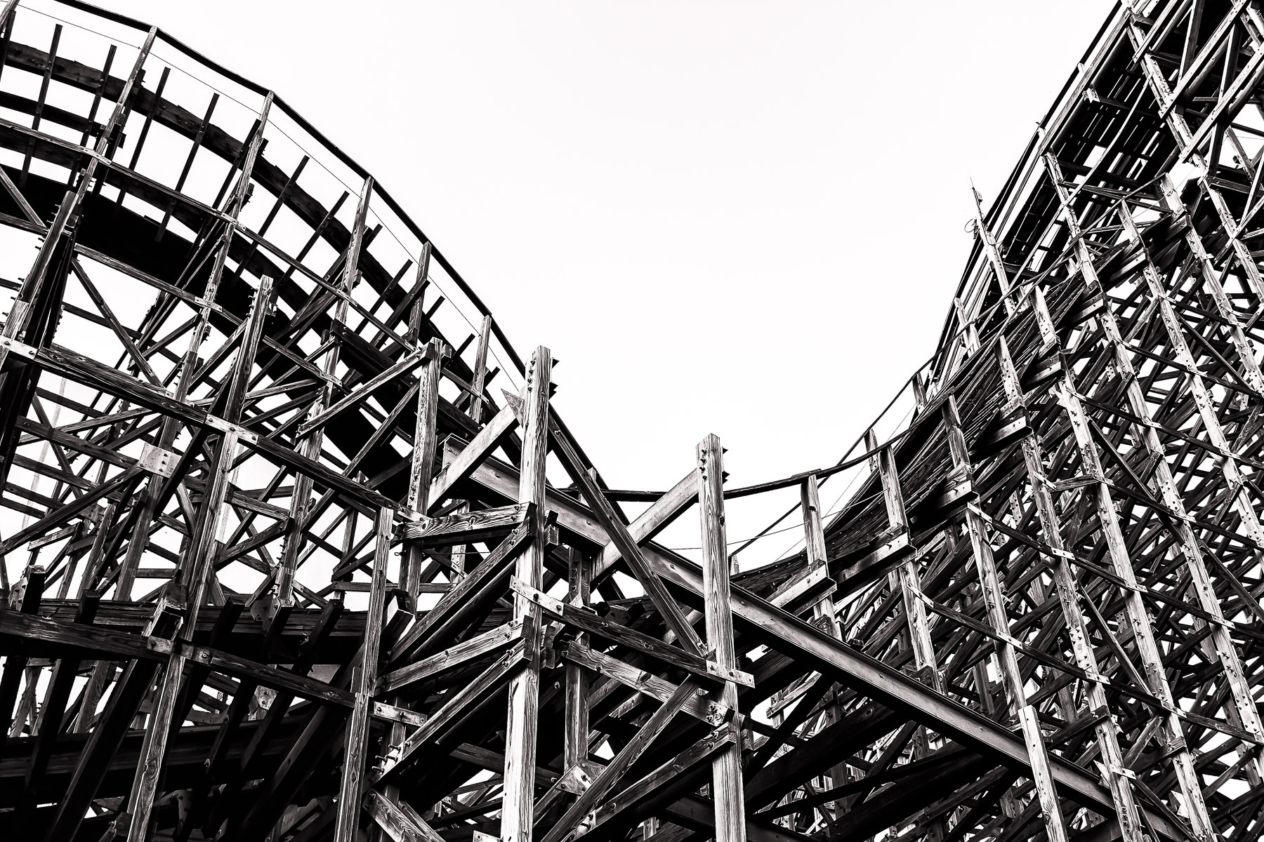 Detail of the wooden supports of the Boardwalk Bullet—the roller coaster at the Kemah Boardwalk in Kemah, Texas.
