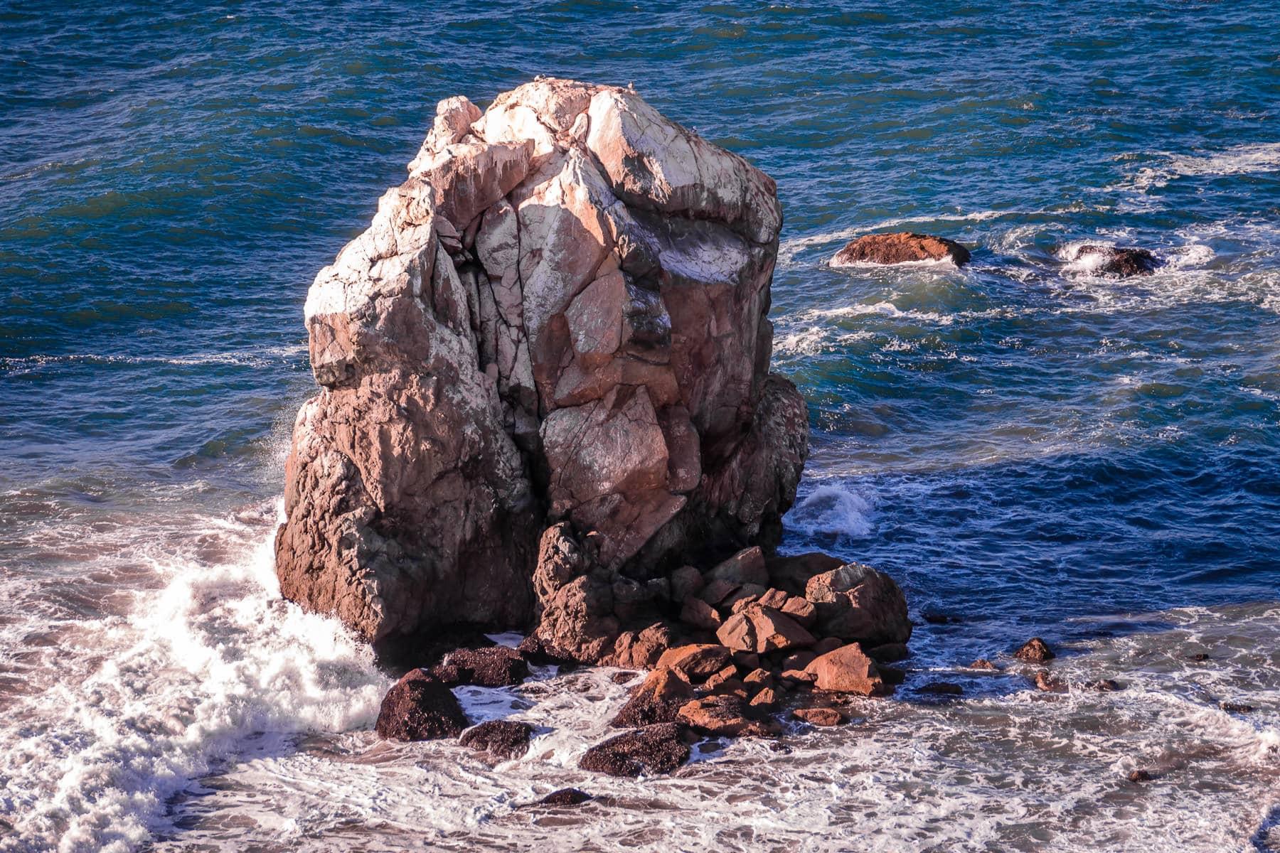 Waves crash onto rocks at San Francisco's Lands End.