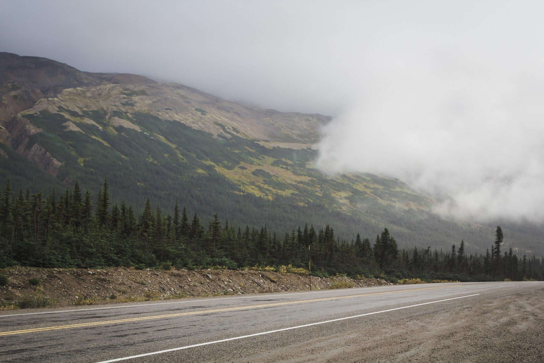 Clouds descend on the Klondike Highway as it wends through the mountains of British Columbia's Stikine Region.