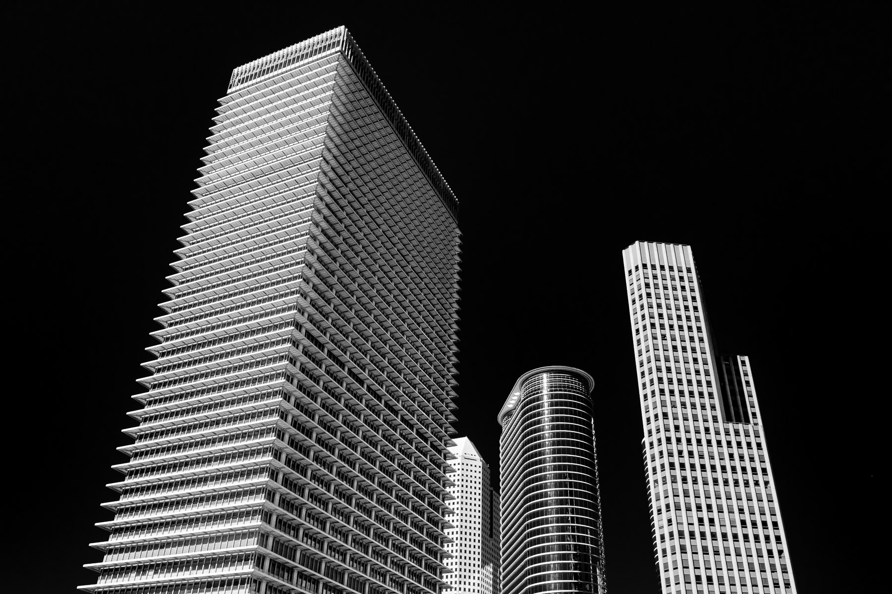 Downtown Houston's ExxonMobil Building, 1600 Smith Street, 1400 Smith Street and Wedge International Tower rise into the Texas sky.