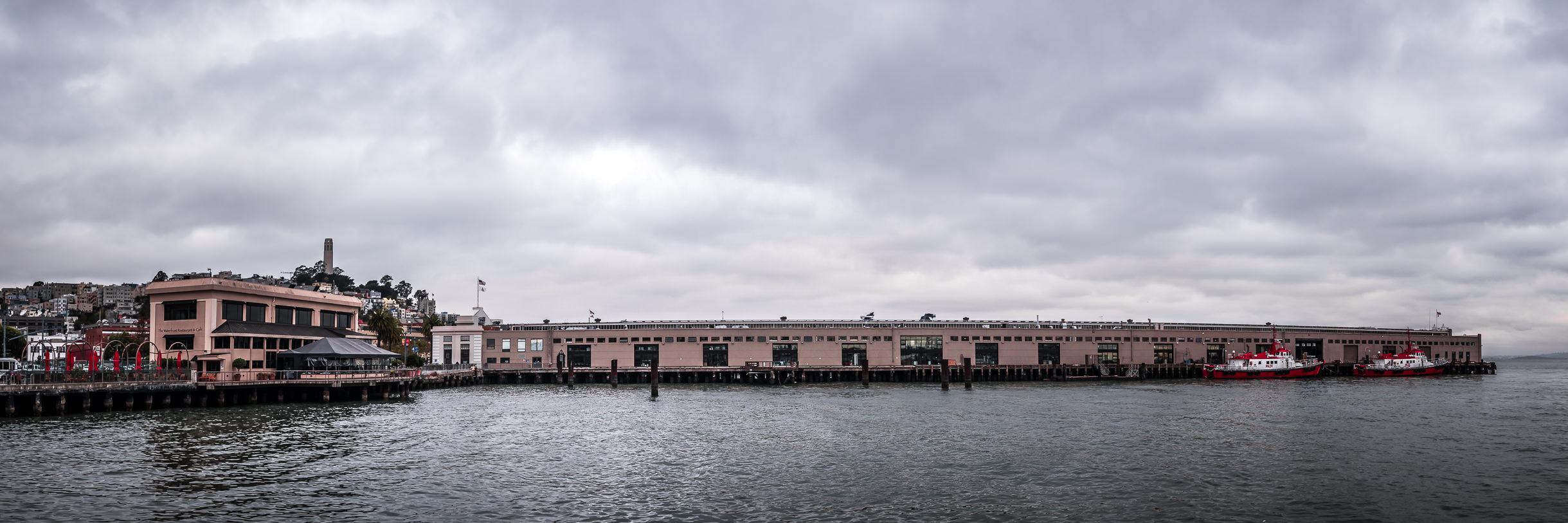 San Francisco's Pier 9 reaches out into the cloud-covered waters of the city's namesake bay.