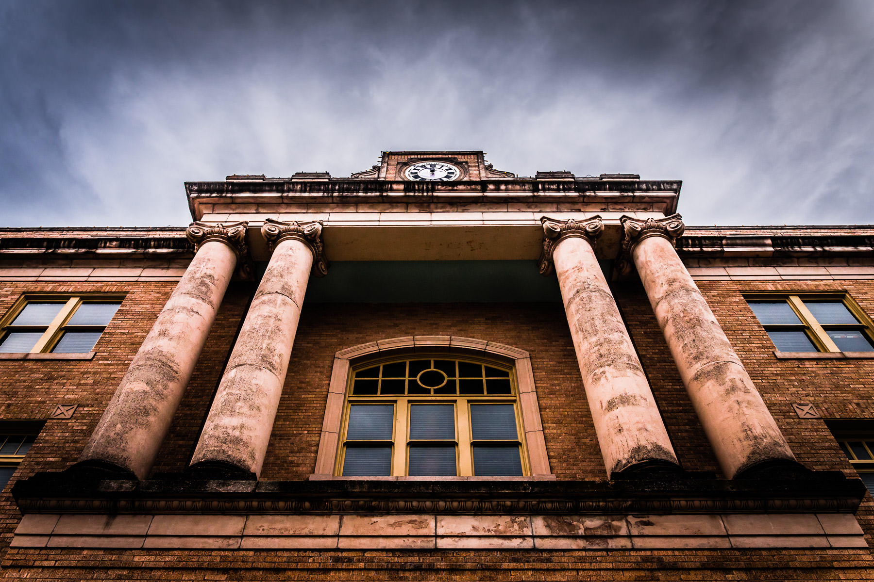 Overcast, stormy skies over the Old Collin County Courthouse, McKinney, Texas.