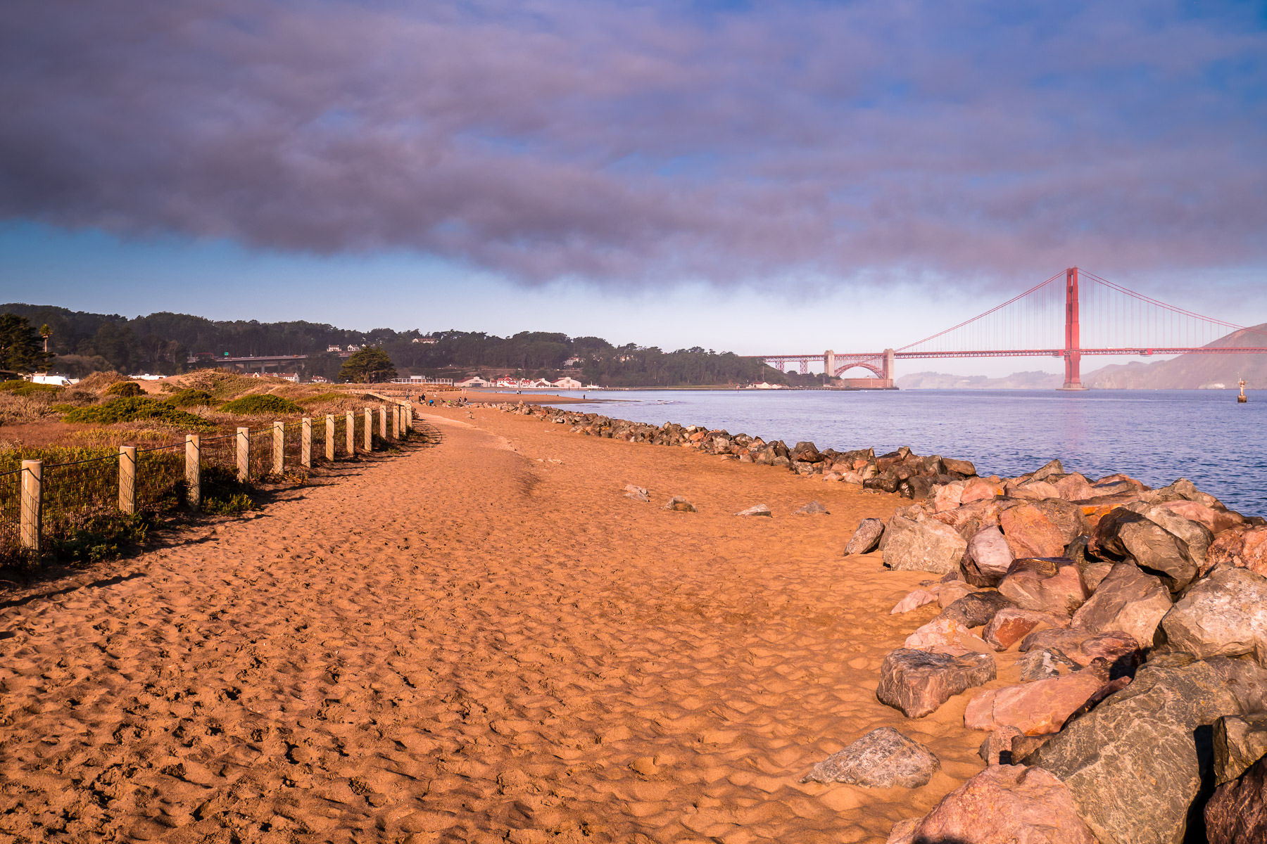 The morning sun lights the sandy beach at San Francisco's Crissy Field.
