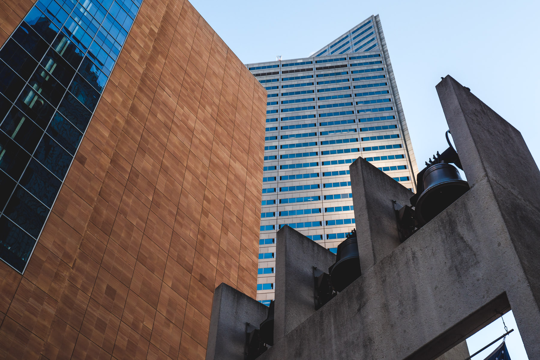 Buildings rise over the bell tower at the Philip Johnson-designed Thanks-Giving Square in Downtown Dallas.