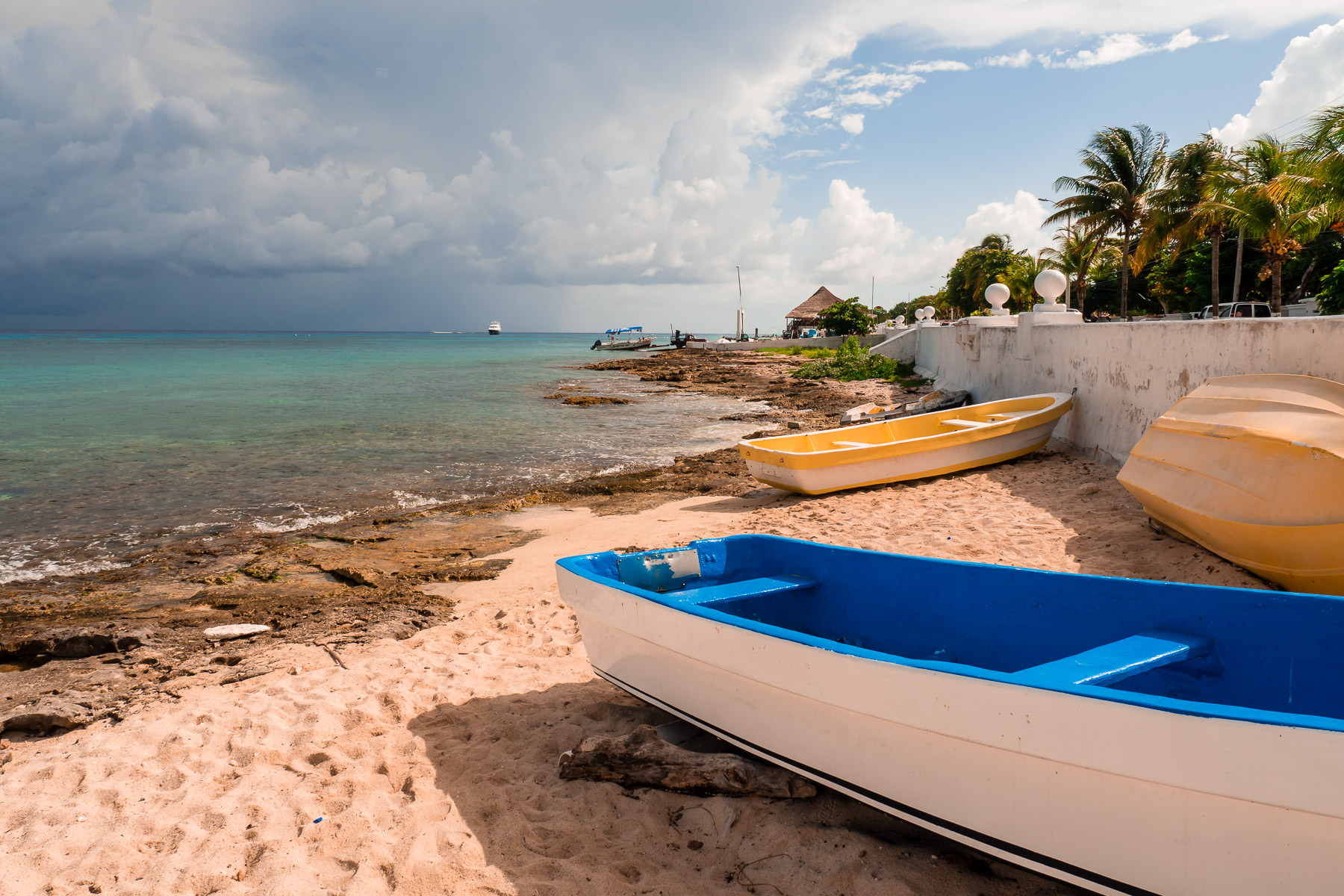 Boats lie on the beach near Downtown San Miguel, Cozumel, Mexico.