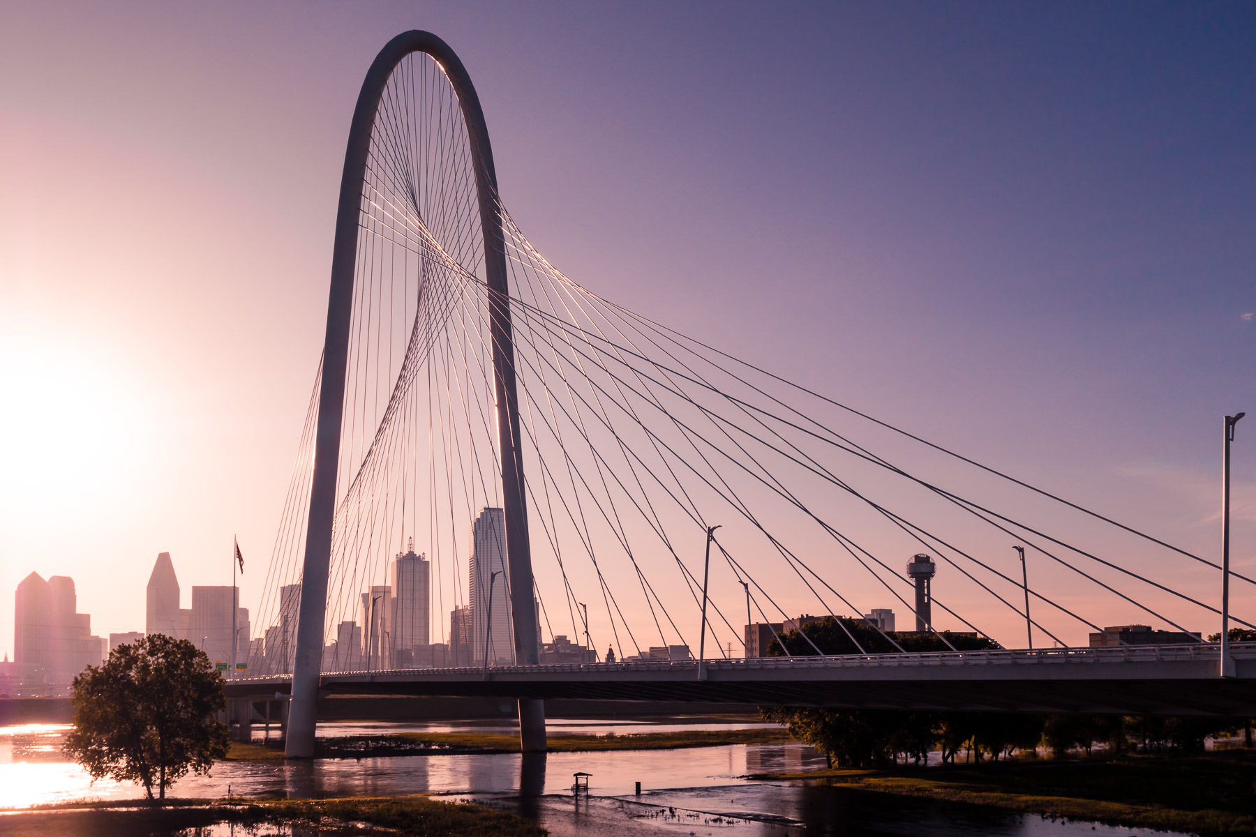The sun rises on the Santiago Calatrava-designed Margaret Hunt Hill Bridge, Dallas, Texas.
