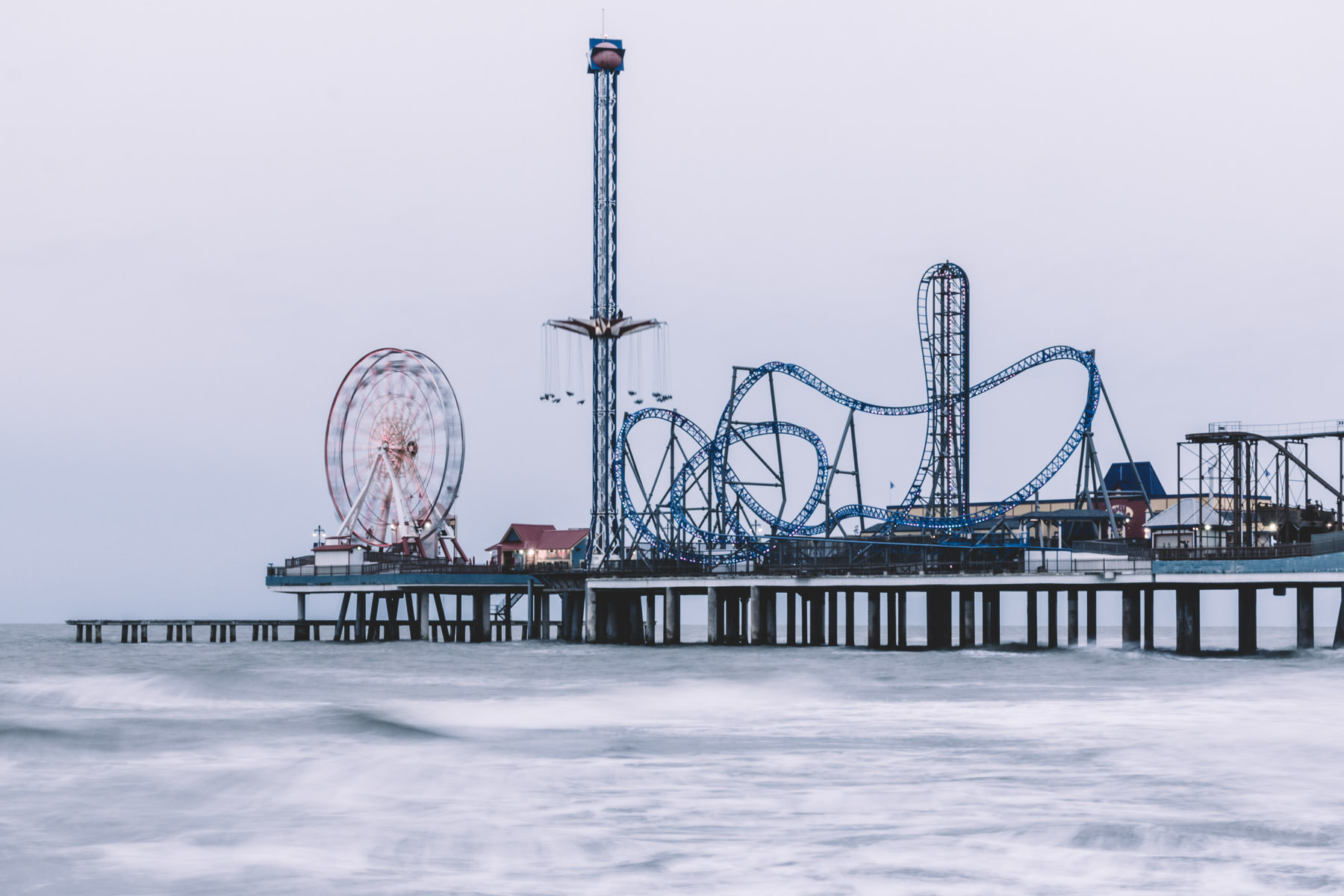 Galveston, Texas' Historic Pleasure Pier reaches out into the cold wind and overcast skies of the Gulf of Mexico.