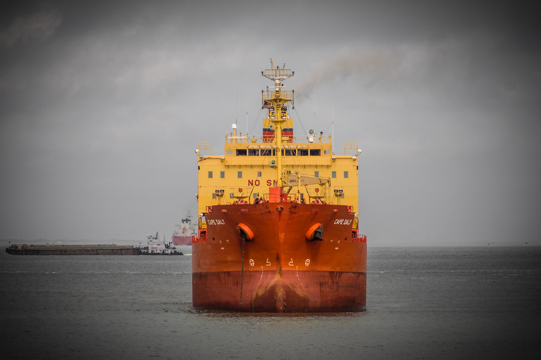 A head-on shot of the chemical tanker Cape Daly, anchored at Bolivar Roads off the coast of Galveston, Texas.