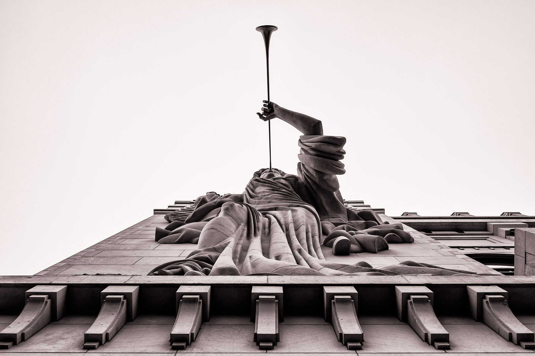 One of two 48-foot-tall trumpet-playing angels on the façade of Fort Worth'sBass Performance Hall.