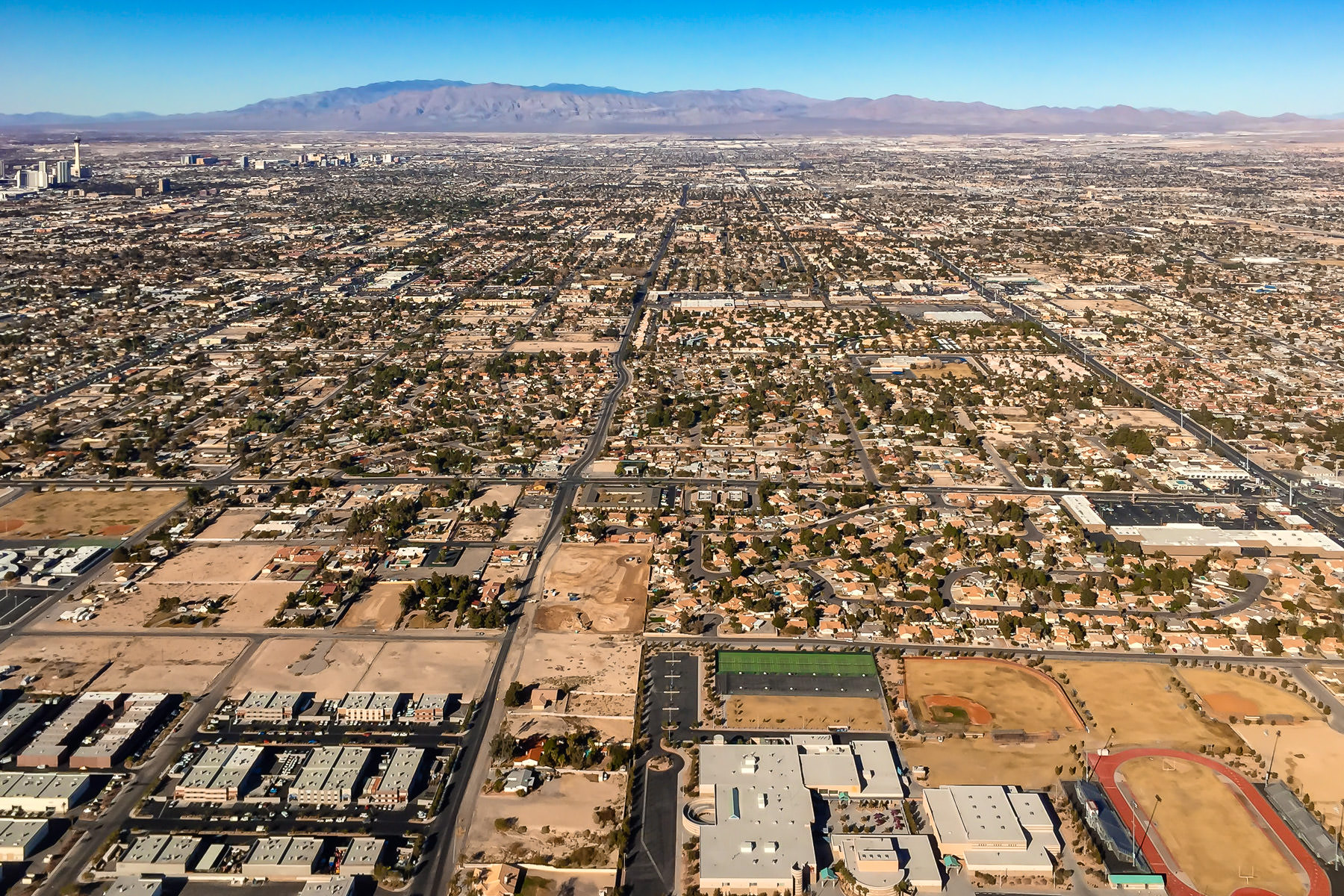 The city grid of Las Vegas rises from the Nevada desert.