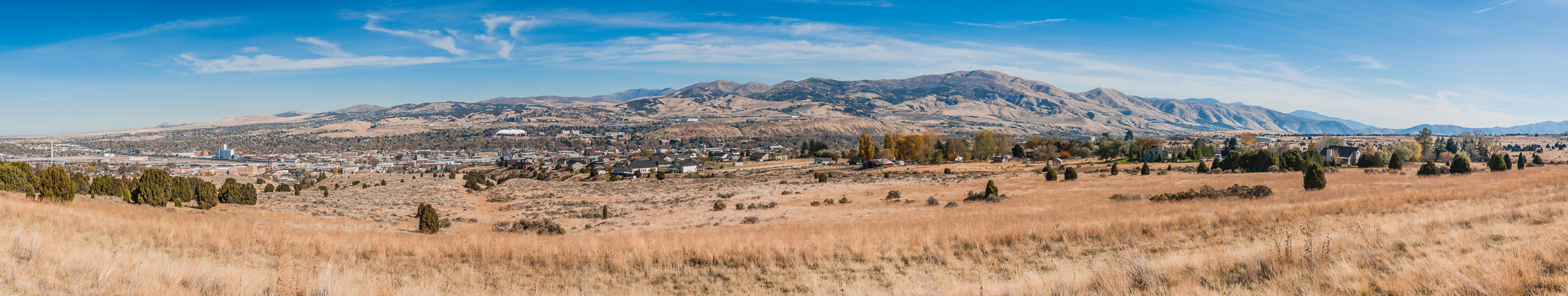 A panoramic view of the city of Pocatello, Idaho, as seen from a nearby hillside.