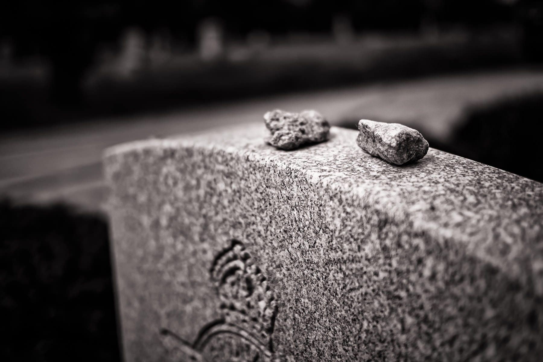 Visitation stones atop a Jewish aviator's grave at the Royal Air Force Cemetery at Oakland Memorial Park in Terrell, Texas. The RAF Cemetery holds the remains of 20 aviators who died while training at the nearby No. 1 British Flying Training School during World War II.