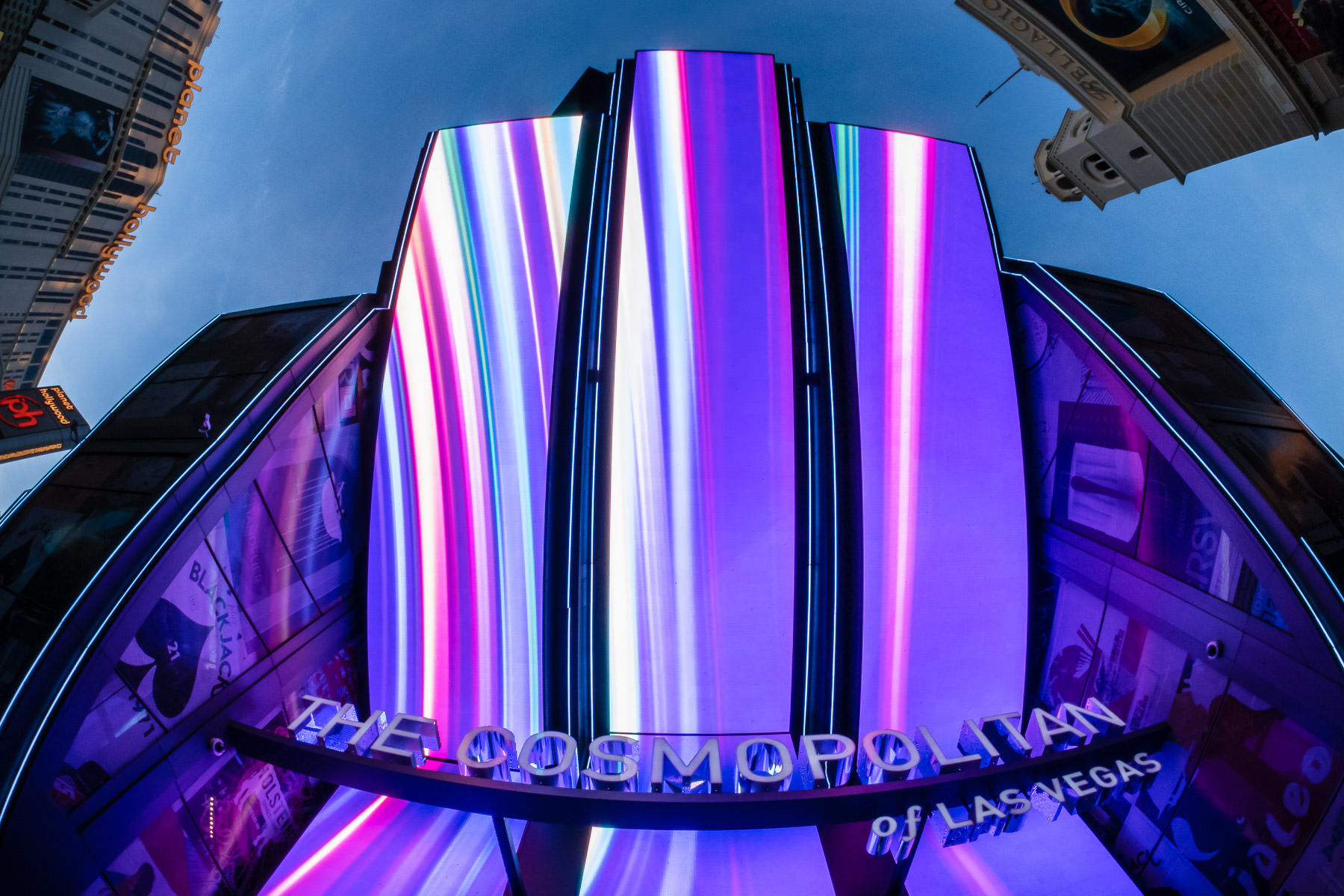 Giant video screens display abstract art above the main entry to the Cosmopolitan of Las Vegas.