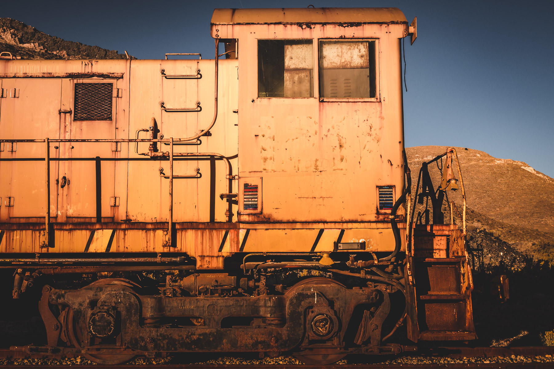 Detail of a train engine abandoned in the desert near Magna, Utah.