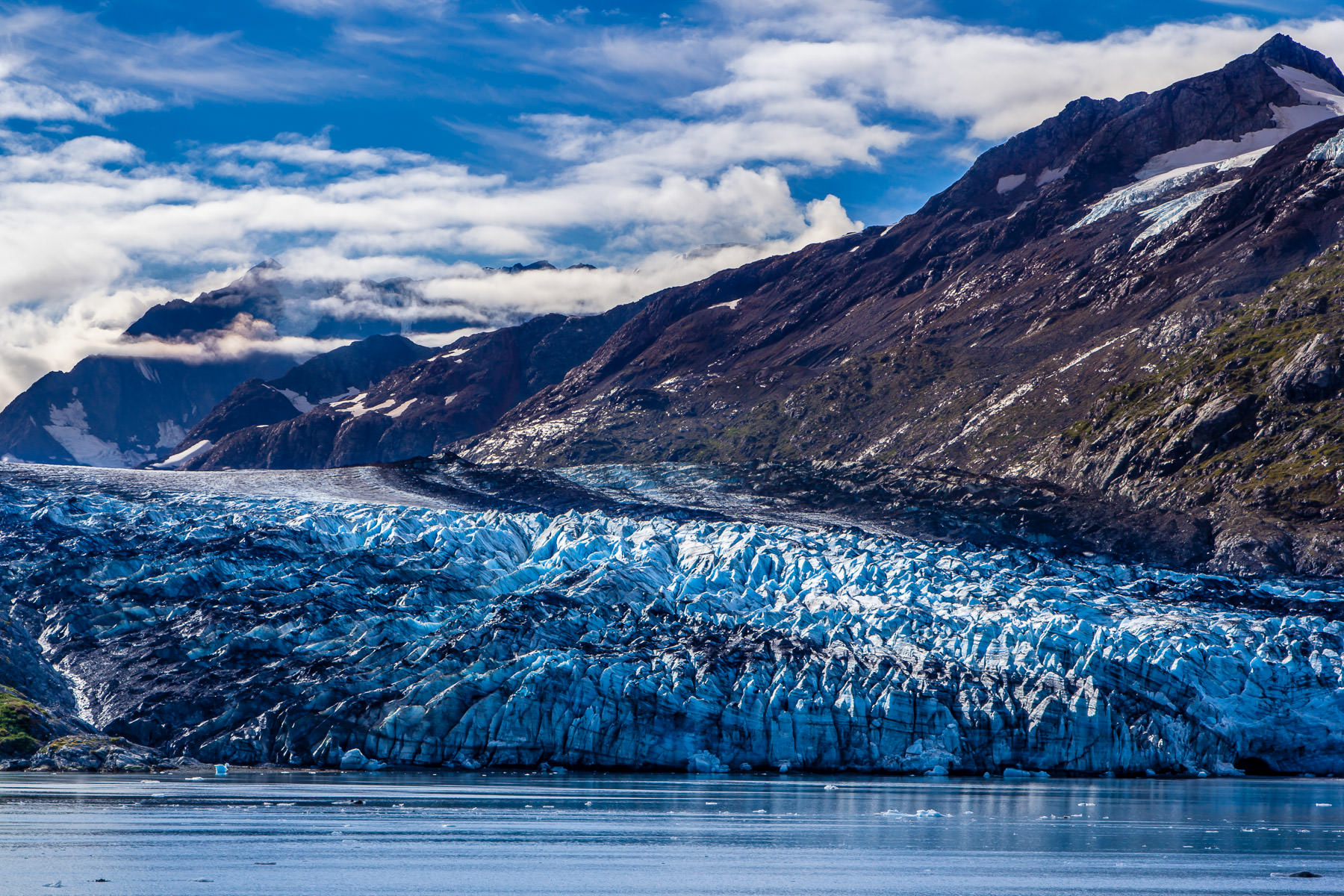 The blue ice of Lamplugh Glacier hugs the coastline of Alaska's Glacier Bay.
