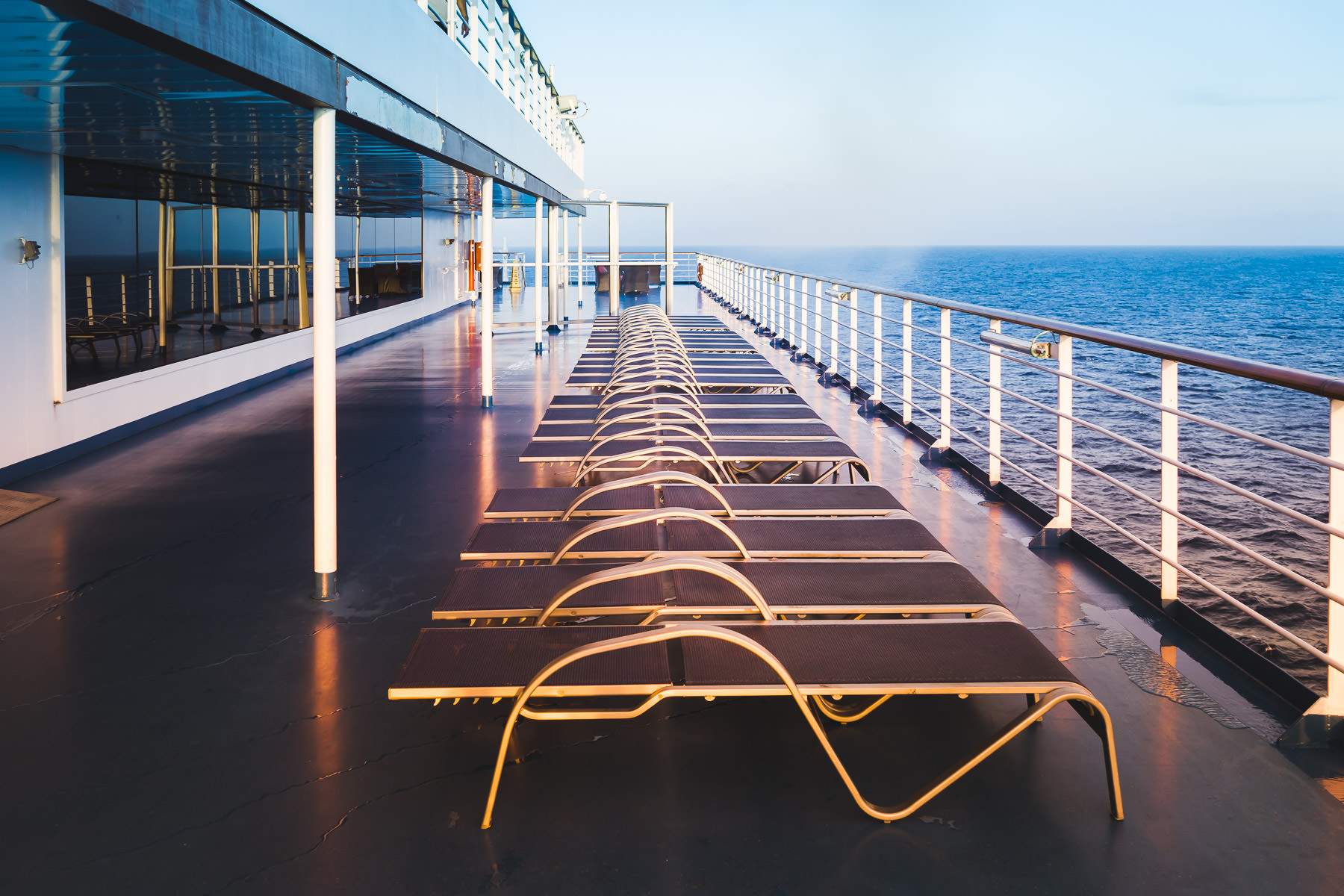 Lounge chairs on the cruise ship Carnival Magic await guests somewhere off the coast of south Florida.