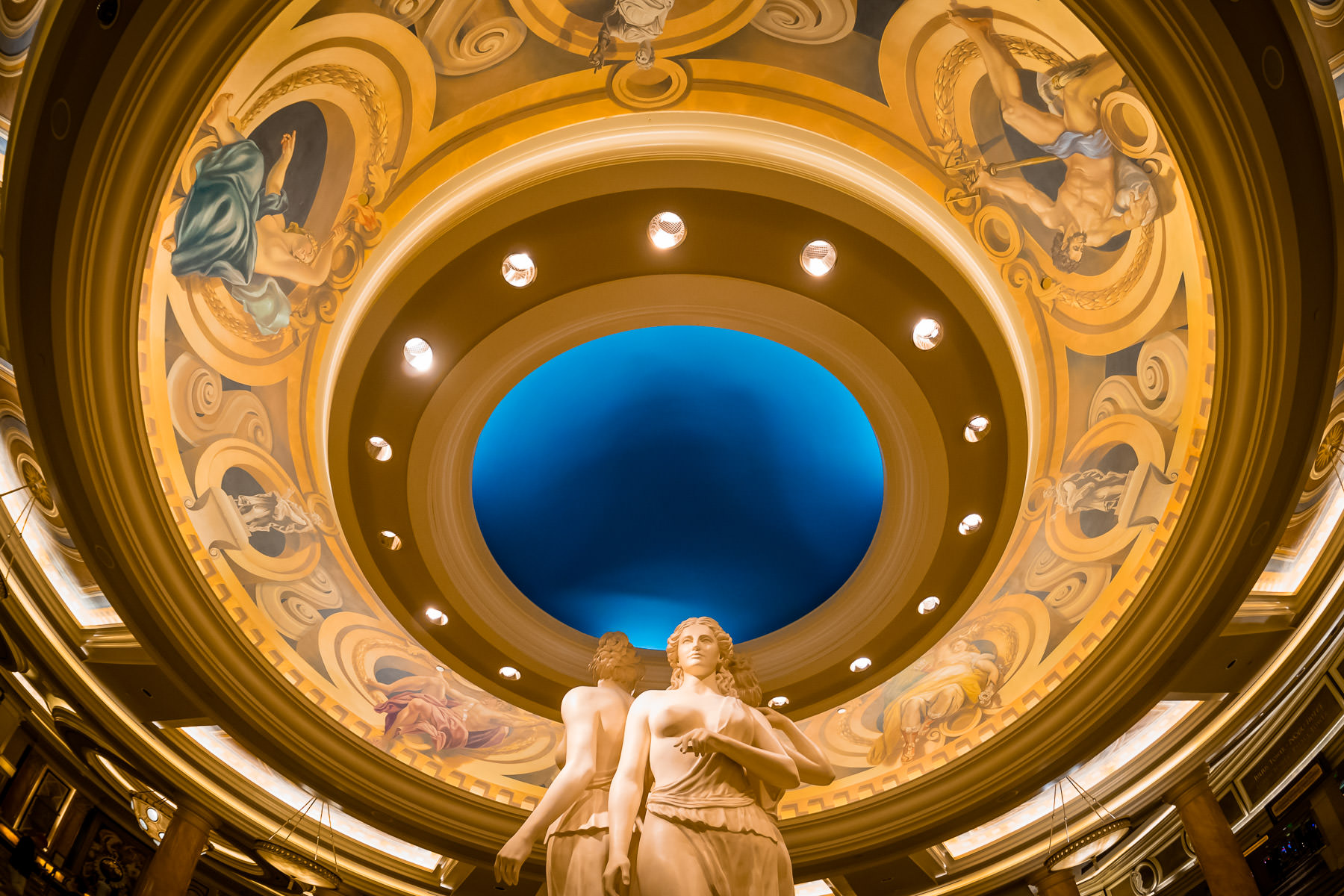 Statues under an ornate ceiling in the lobby of Caesars Palace, Las Vegas.