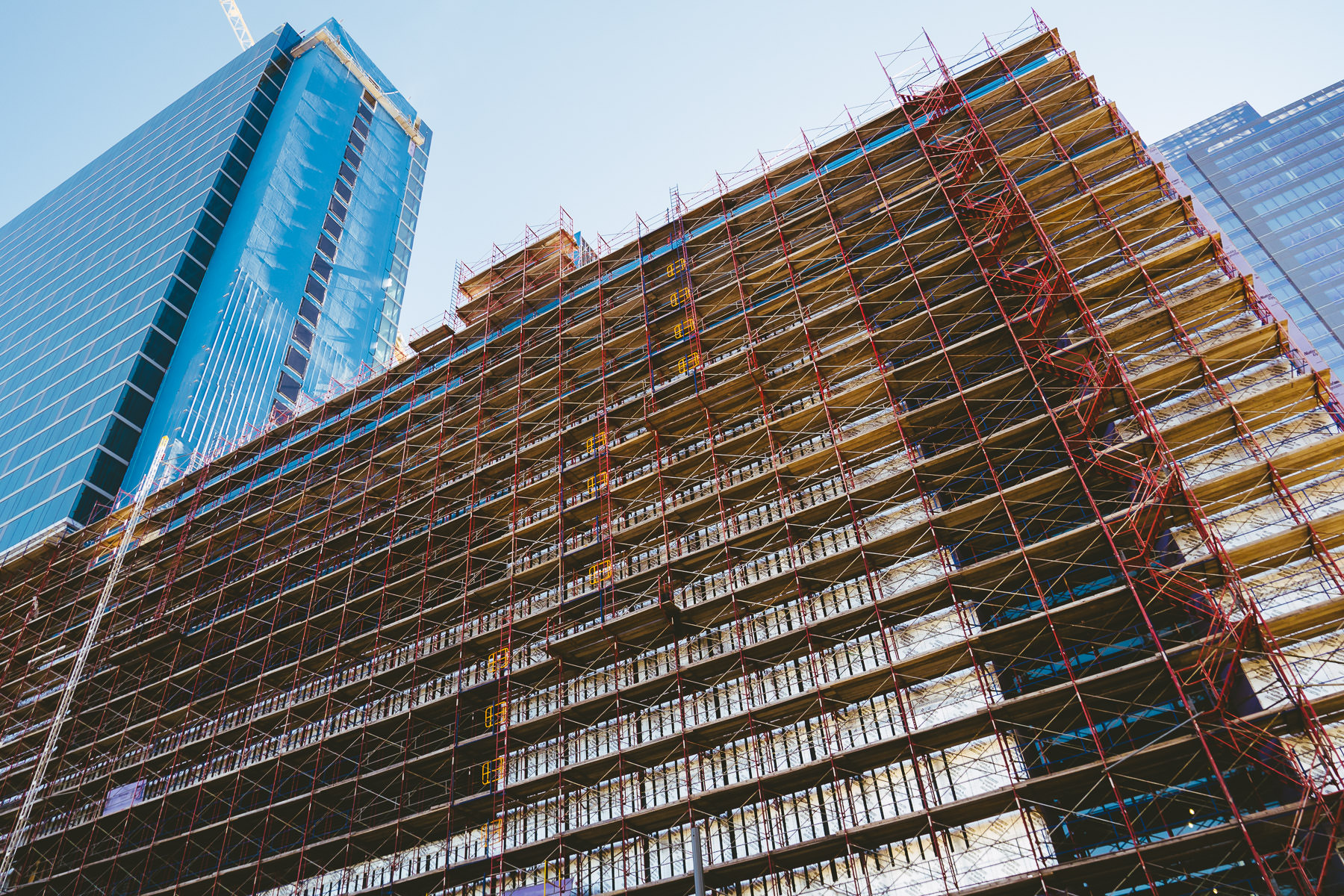 A massive scaffold surrounds a construction site in Downtown Houston, Texas.
