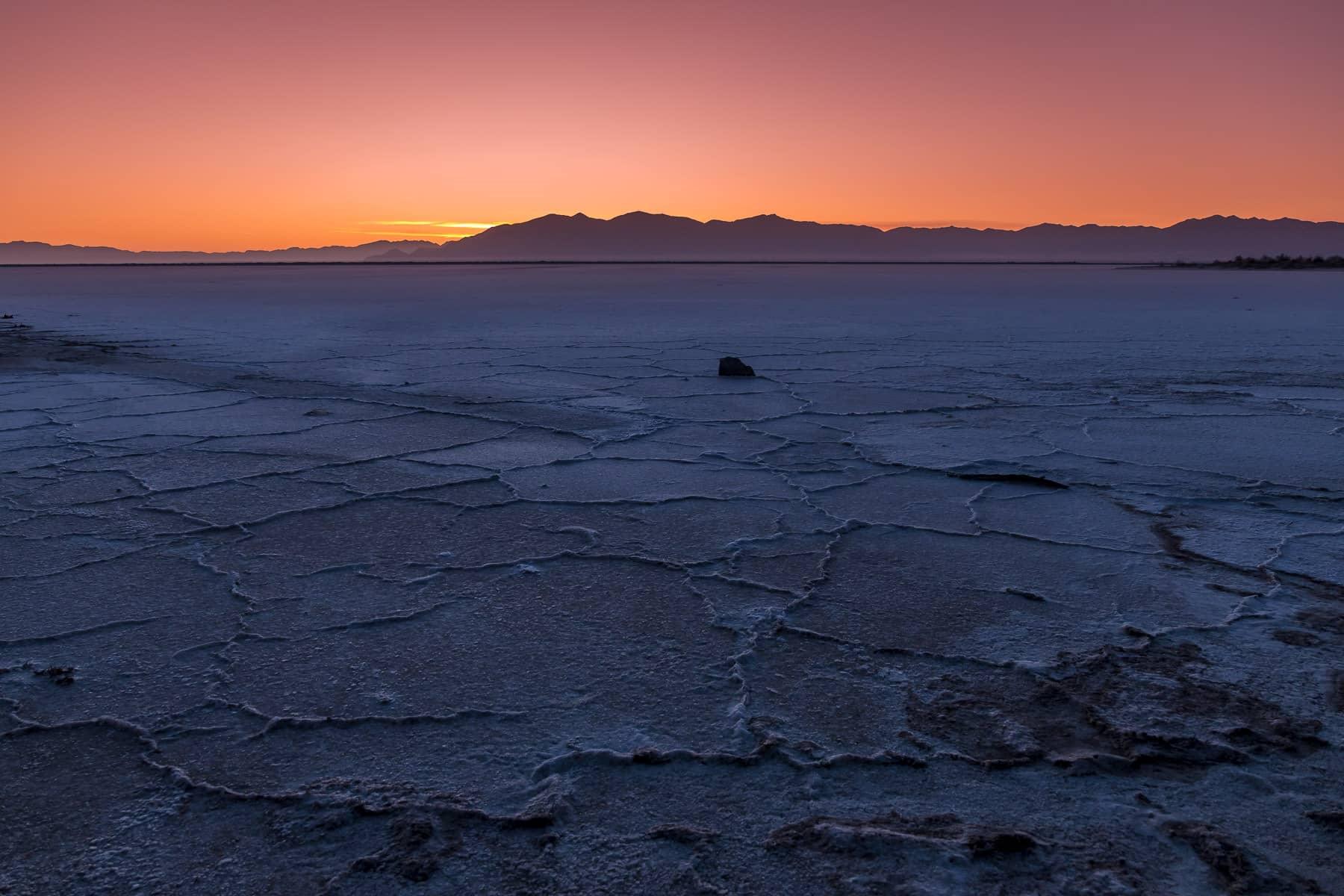 The sun rises on the dried salt flat shore of the Great Salt Lake, Utah.