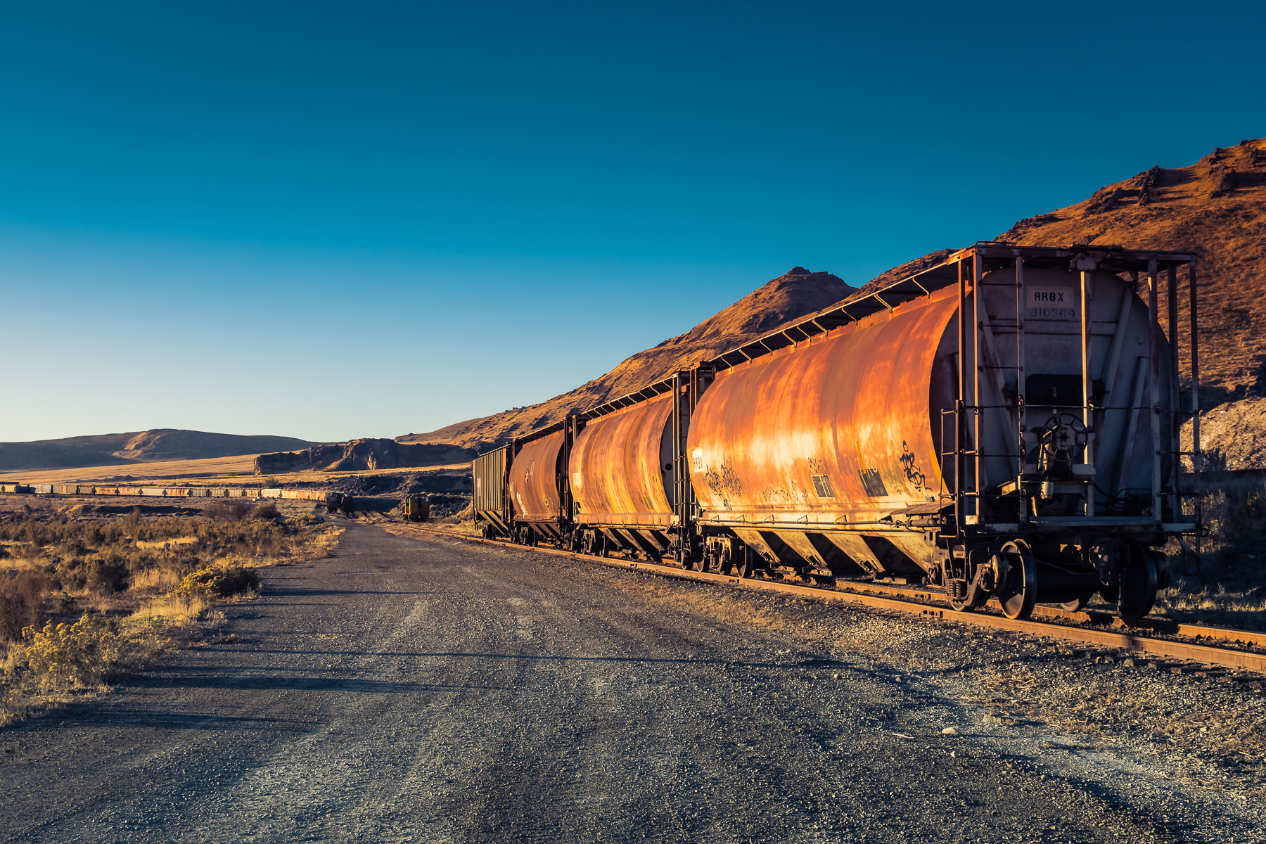 Railcars sit abandoned on a rail siding near Magna, Utah.