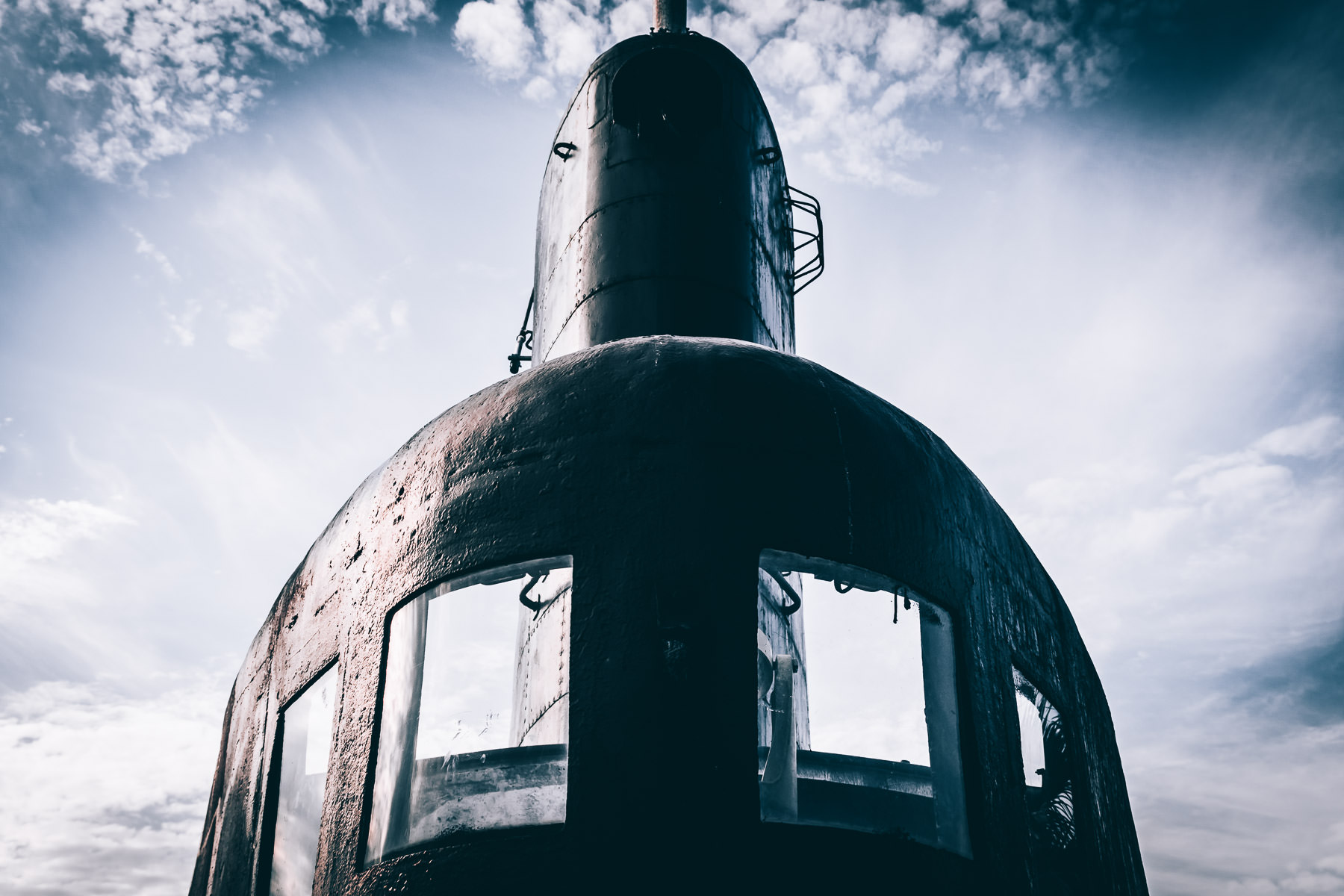 The sail (or conning tower) of the Gato-class submarine USS Cavalla rises into the late afternoon sky over Galveston, Texas' Seawolf Park.