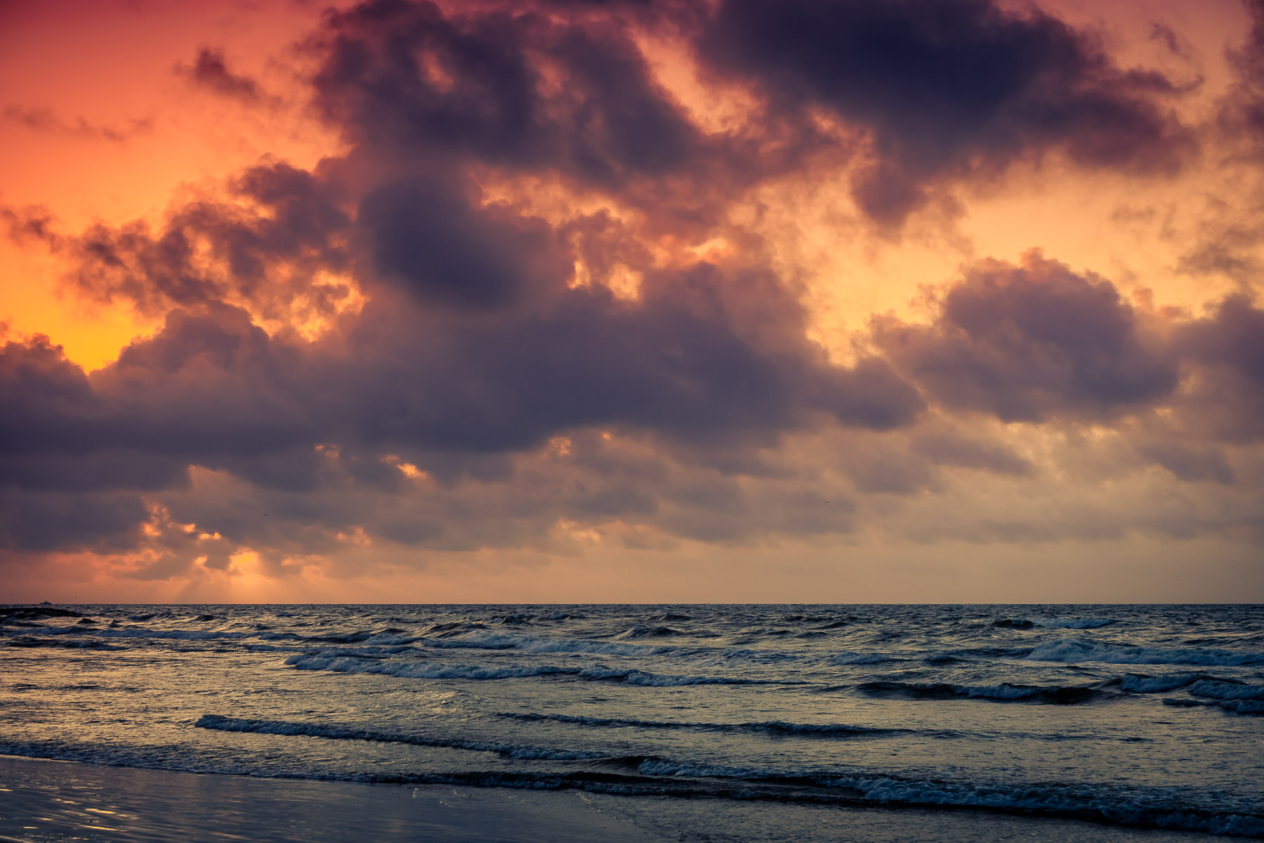 A morning red sky over the Gulf of Mexico off the coast of Galveston, Texas, portends bad weather according to an old mariner's rhyme.