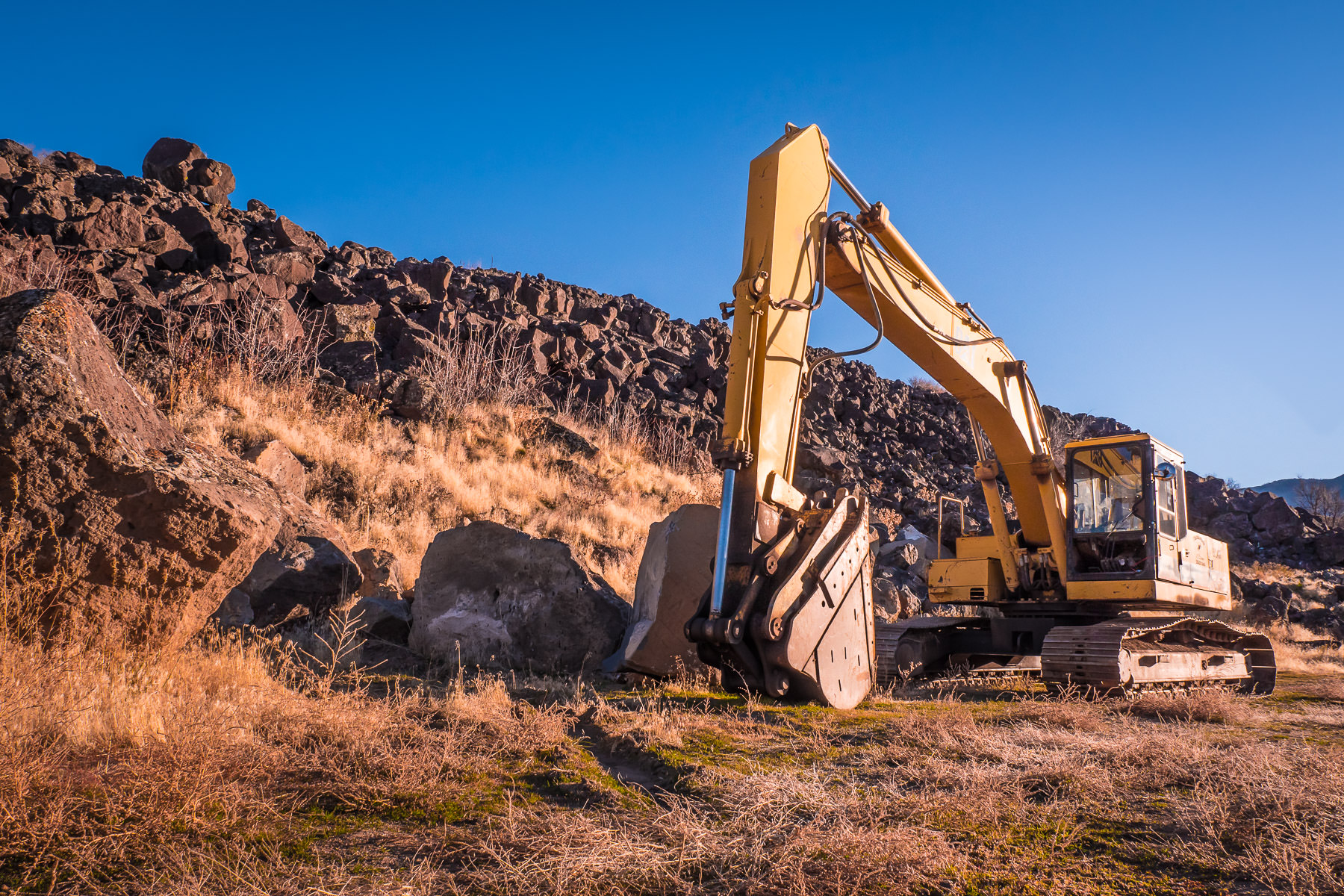 A backhoe sits among volcanic basalt flows near Inkom, Idaho.